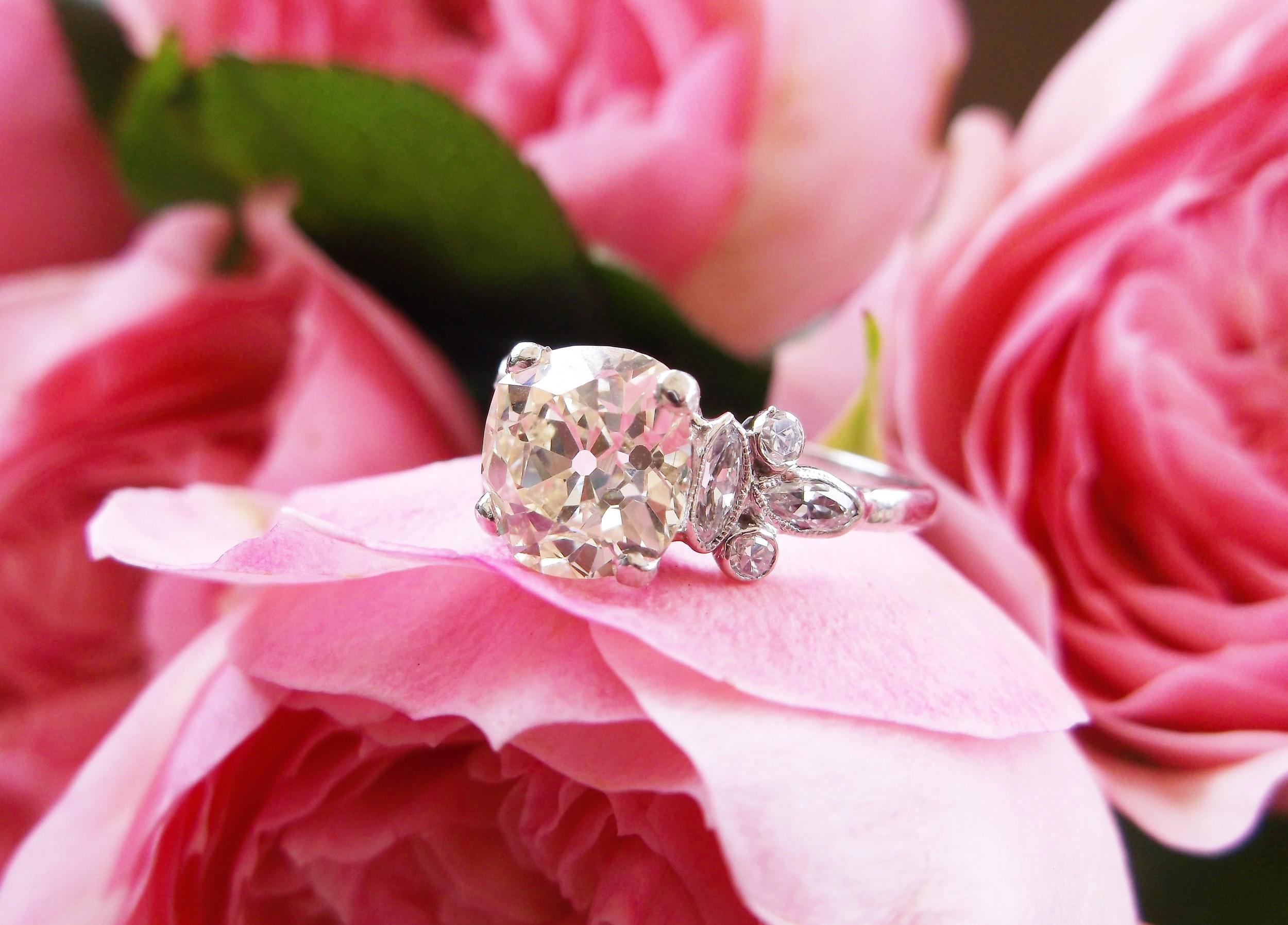 Ravishing 2.38 carat Old Mine cut diamond set in a lovely diamond and platinum mounting.