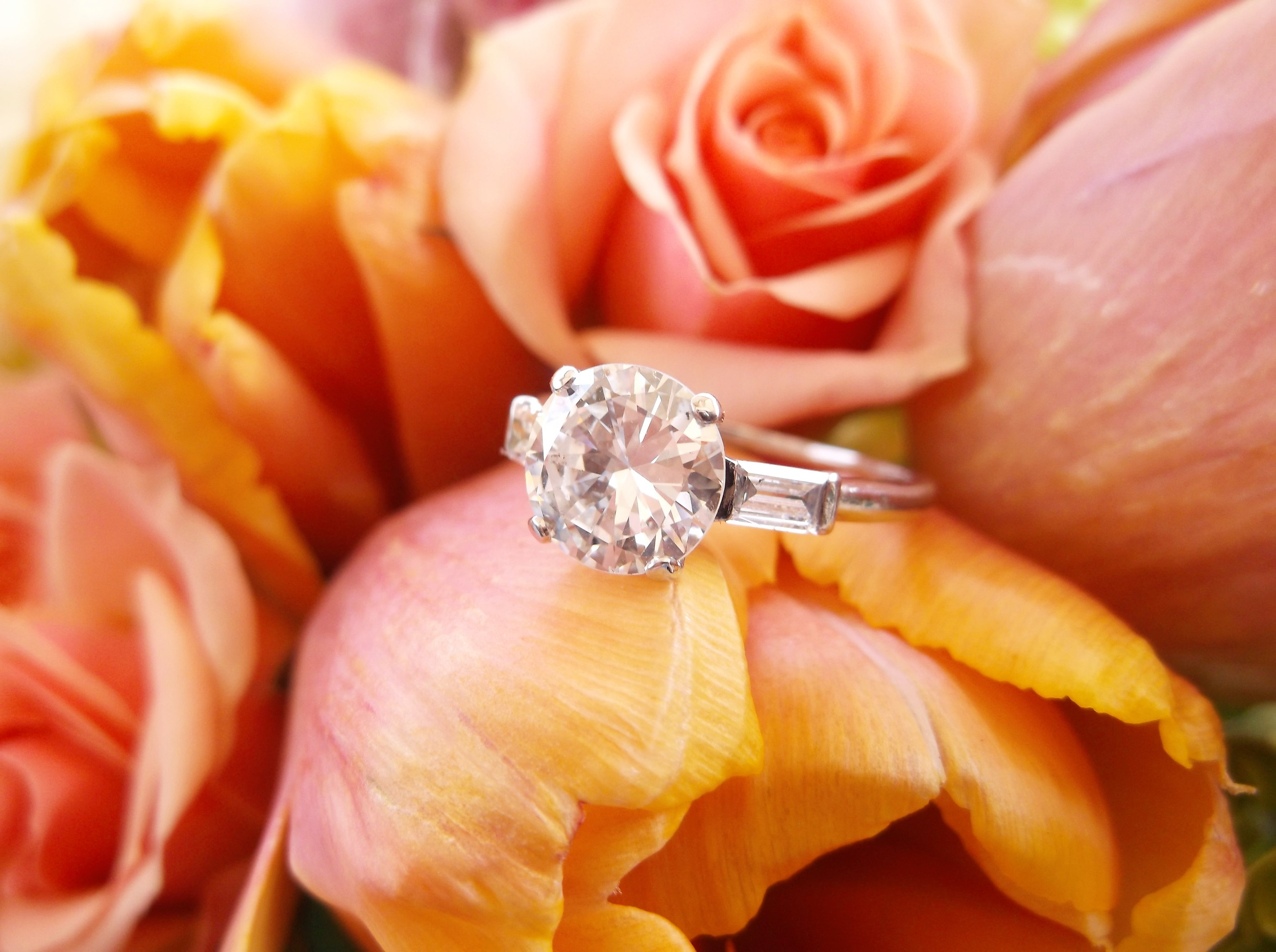 SOLD - Iconic 1.80 carat Old European cut diamond with a baguette cut diamond on each side, set in platinum.