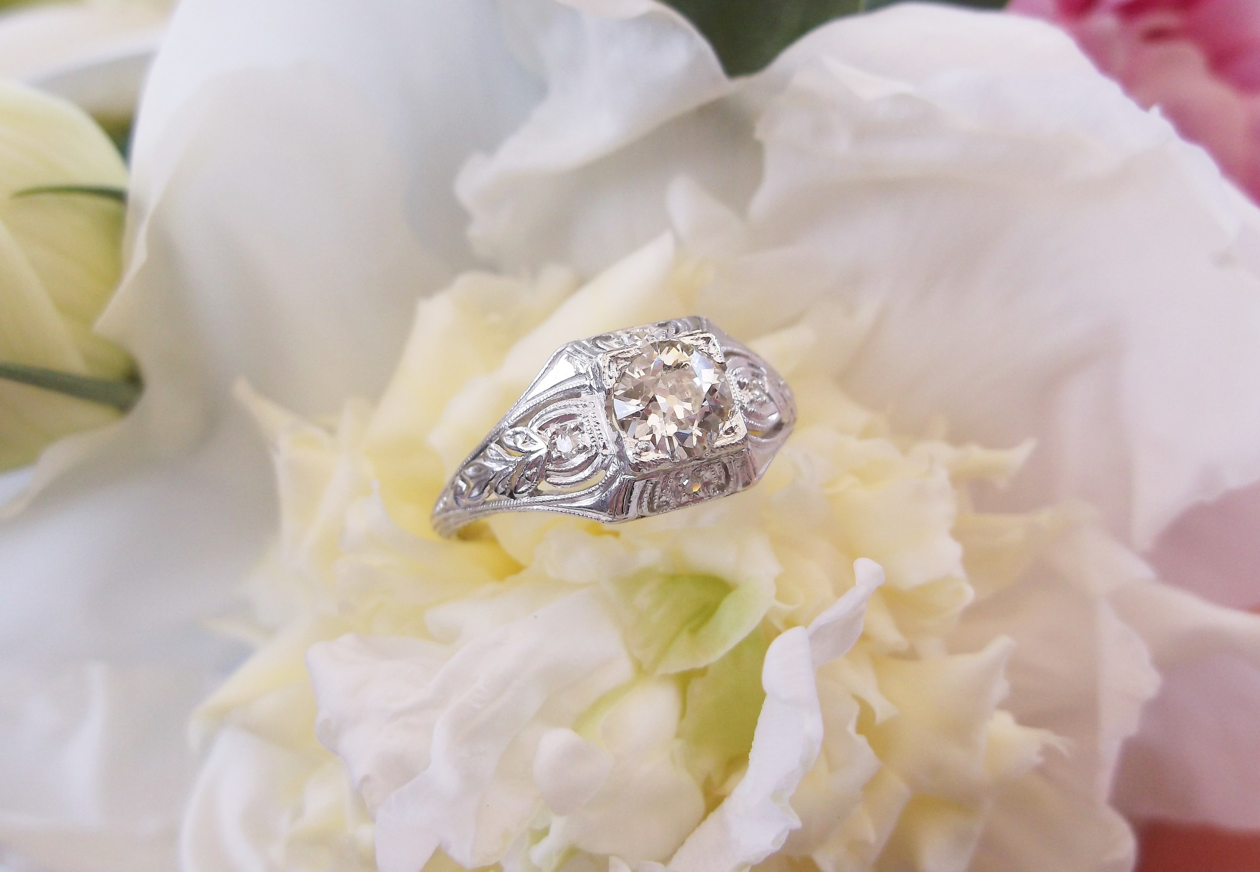 SOLD - Artfully crafted 1920's Old Mine cut diamond and platinum ring with a 0.62 carat Old Mine cut diamond in the center.