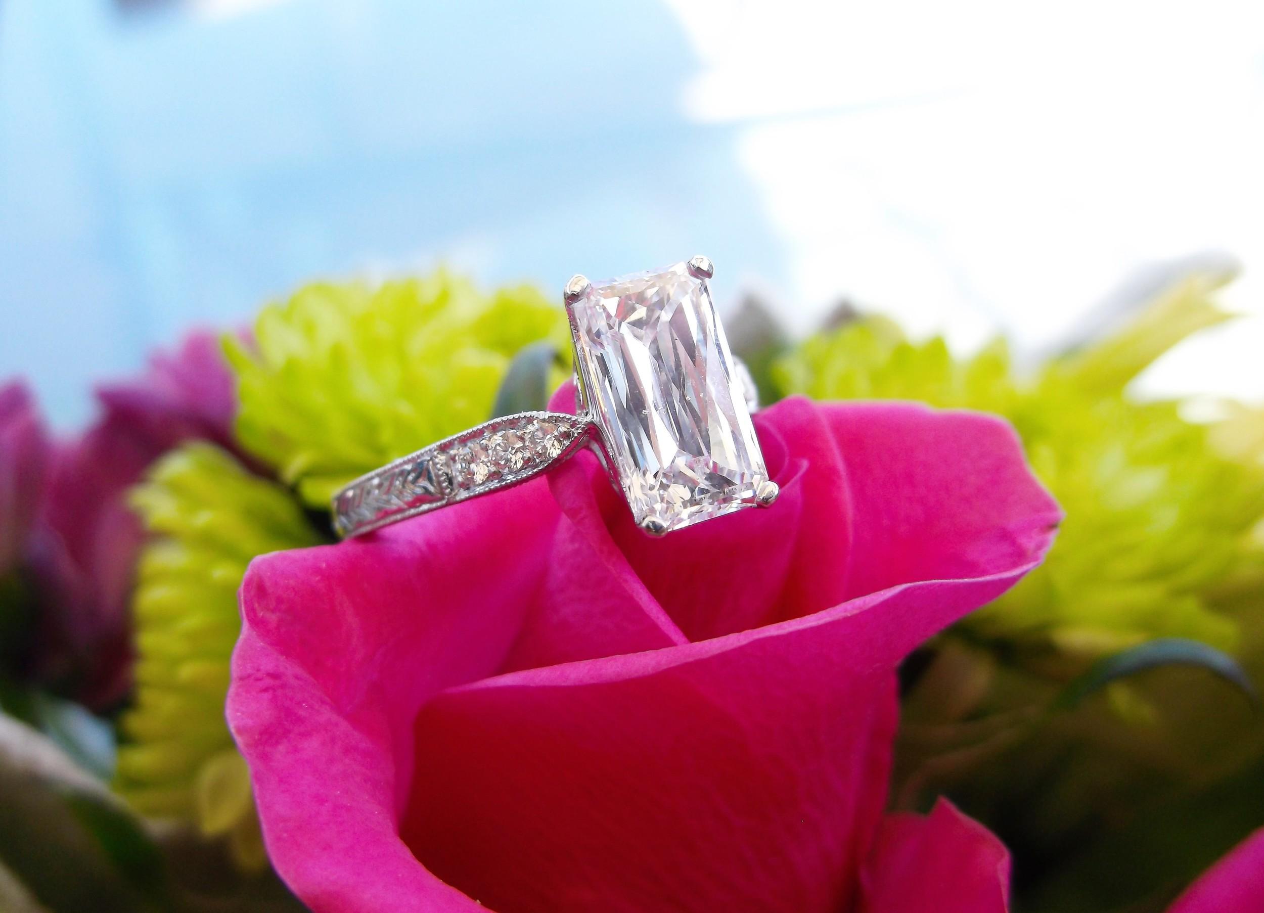 Mesmerizing 1.67 carat scissor cut diamond set in a beautiful diamond and platinum mounting.