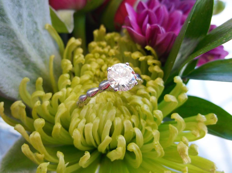 Gorgeous 1.30 carat round brilliant cut diamond in a beautiful white gold and diamond detail mounting.
