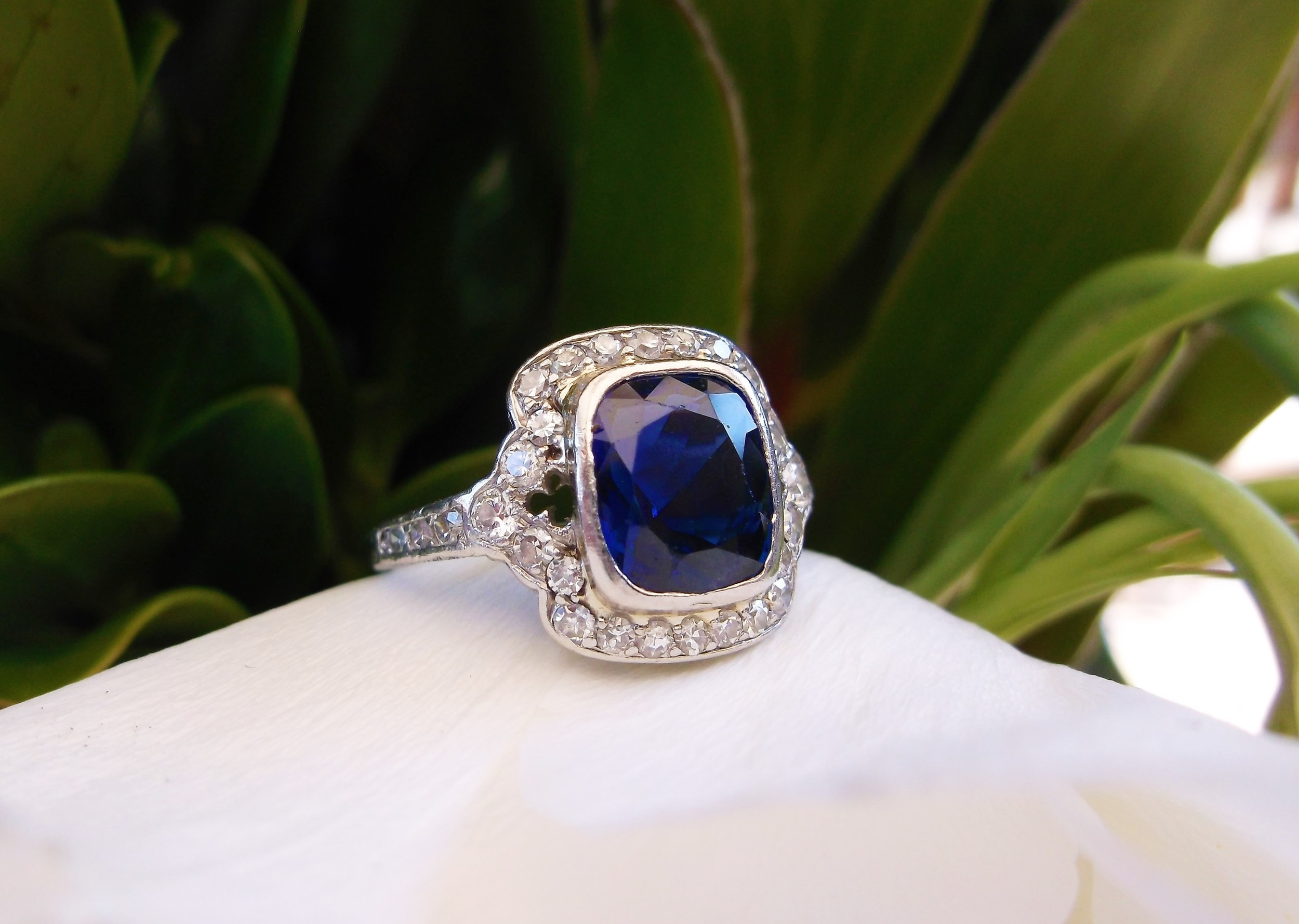 SOLD - Mesmerizing 1920's 2.25 carat blue sapphire set in a lovely diamond and platinum mounting.
