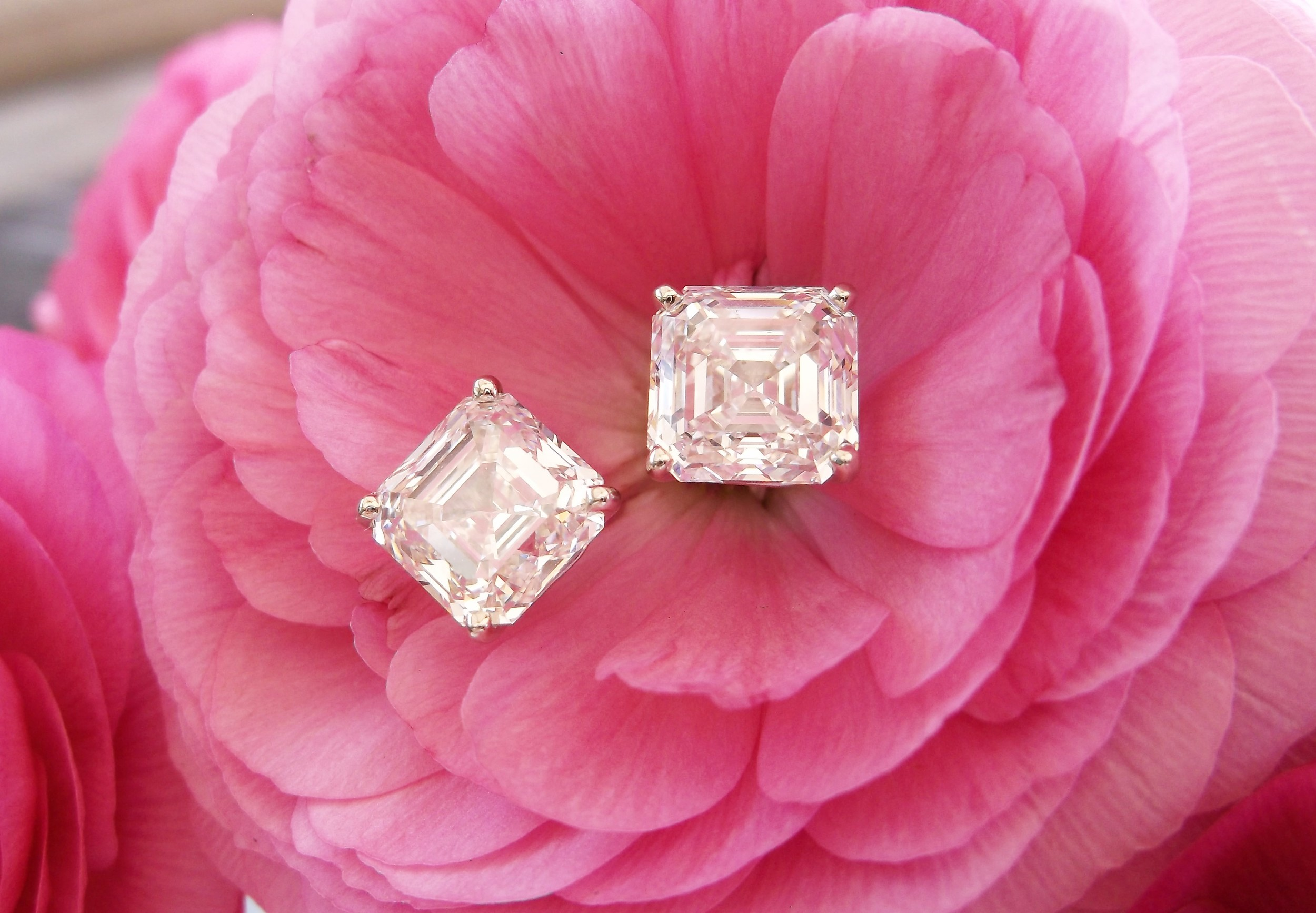 SOLD - The most perfect pair of asscher cut diamond earrings we have ever seen! 3.89 carats in one ear and 4.04 carats in the other!