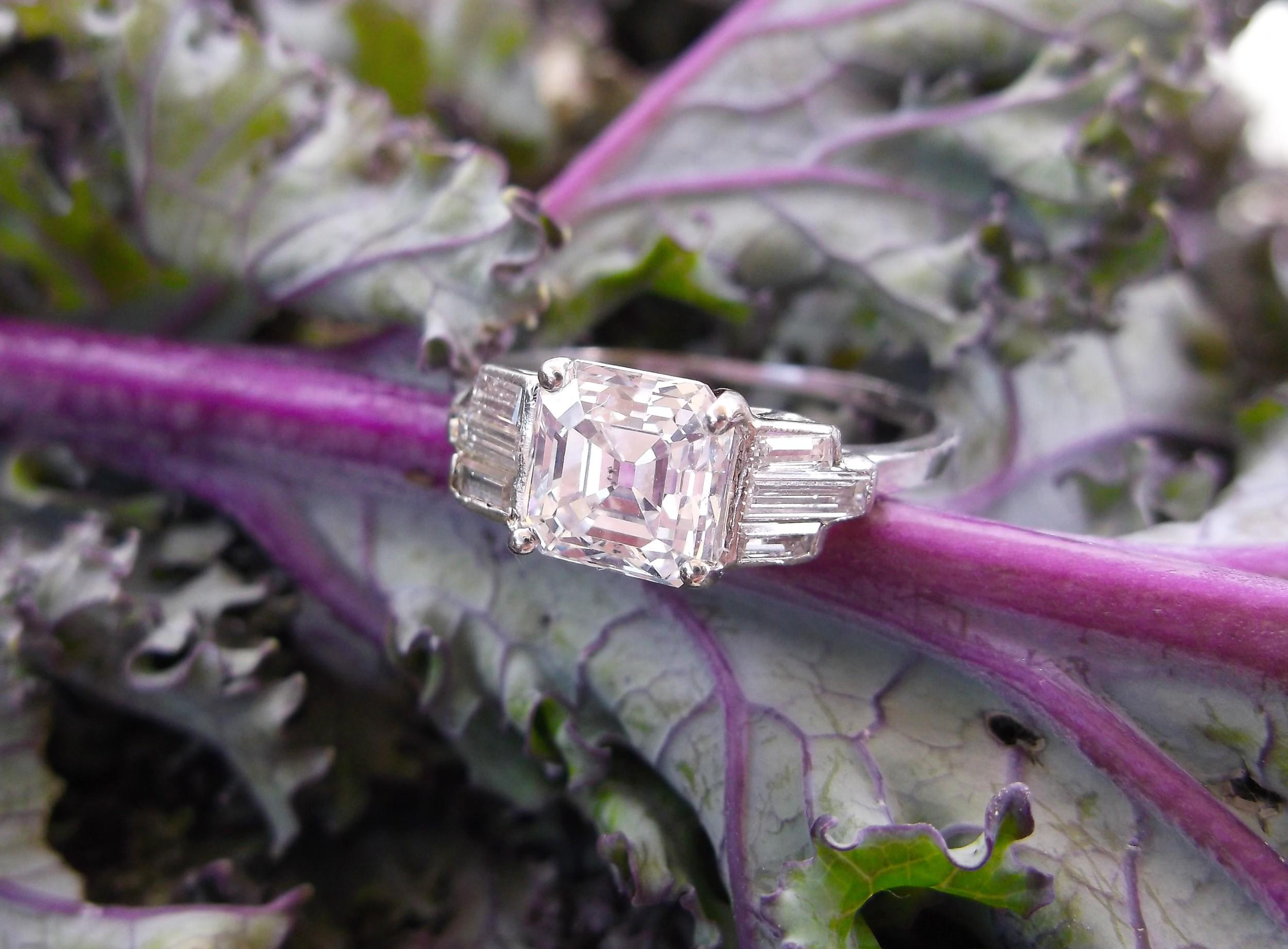 SOLD - Sophisticated Art Deco 1.13 carat asscher cut diamond, flanked by three baguette cut diamonds on each side.