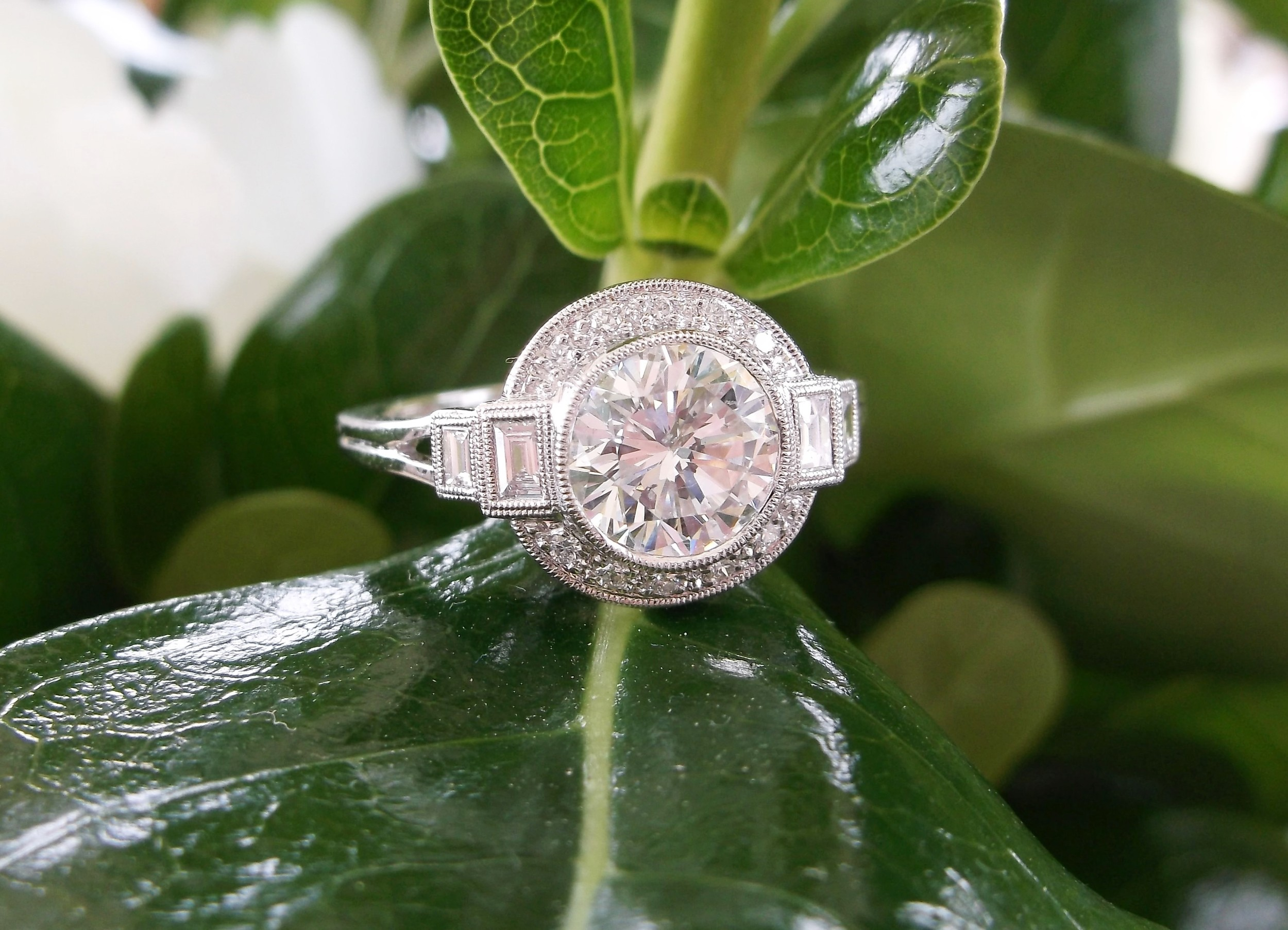 A gorgeous 1.29 carat diamond set in a beautifully crafted diamond and platinum mounting.