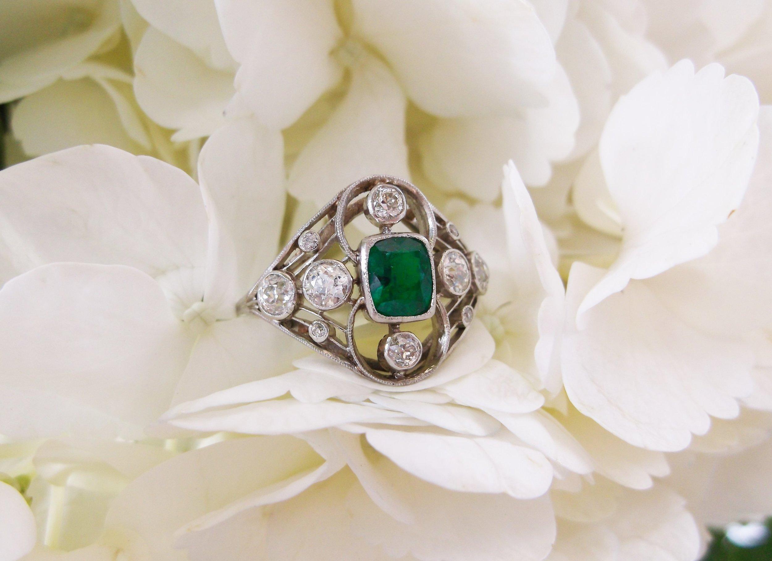 SOLD - Dreamy Edwardian era emerald and Old Mine cut diamond ring set in platinum.
