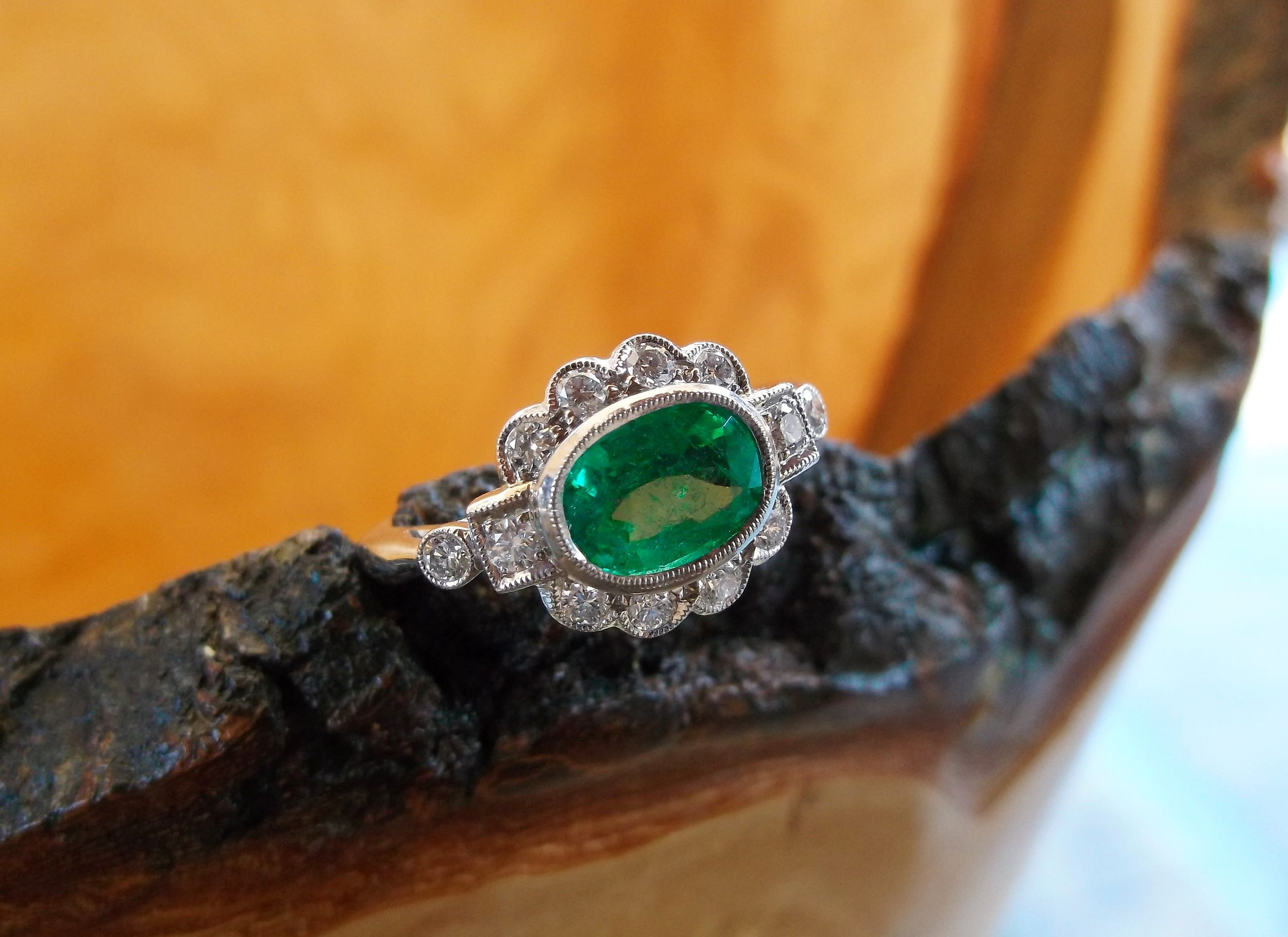 SOLD - Romantic 1.39 carat emerald ring surrounded by 0.35 carats total weight in diamonds.