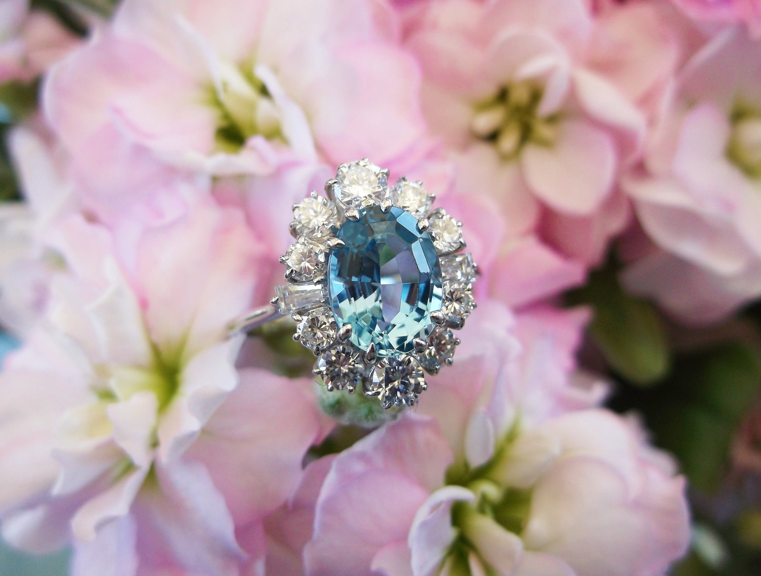 SOLD - Fanciful 1.75 carat aquamarine ring surrounded by 1.00 carat total weight in diamonds set in white gold.