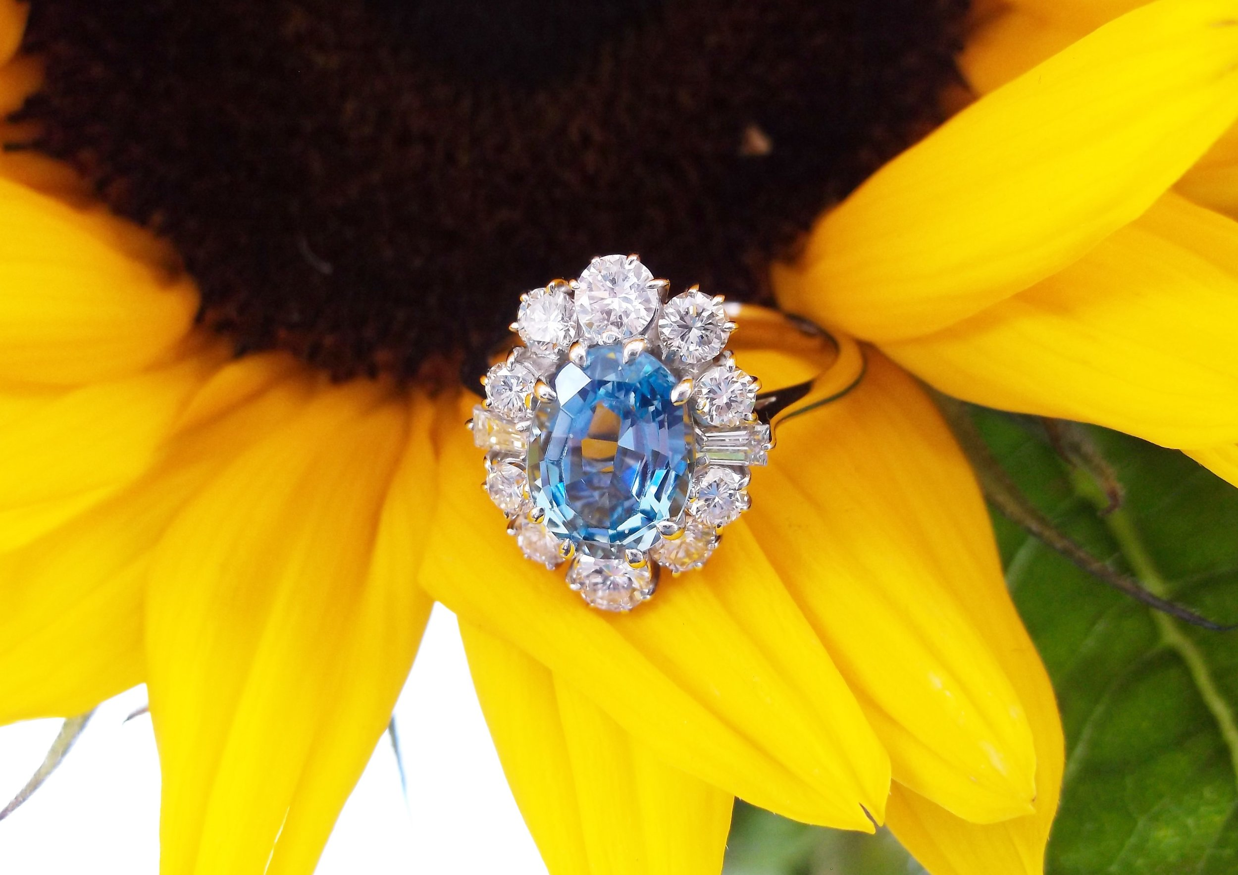 SOLD - Darling 1.75 carat aquamarine, surrounded by 1.00 carats total weight in diamonds.