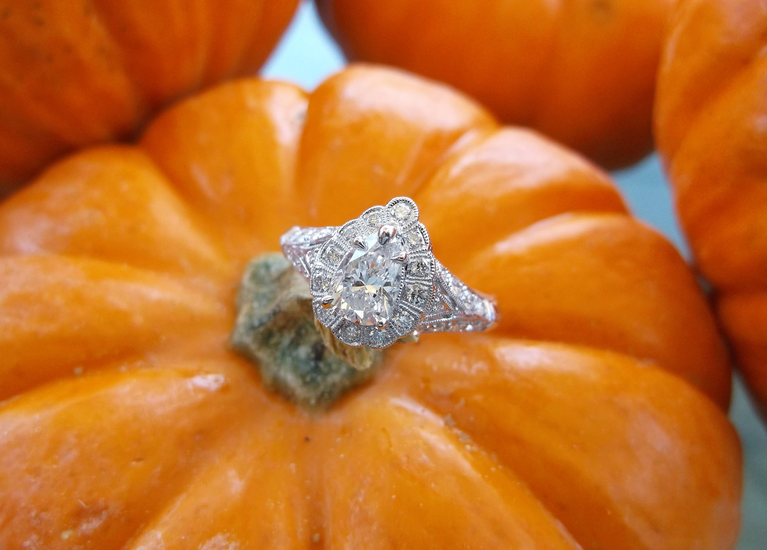 SOLD - Enchanting 0.62 carat pear shaped diamond set in a detailed diamond and white gold mounting.