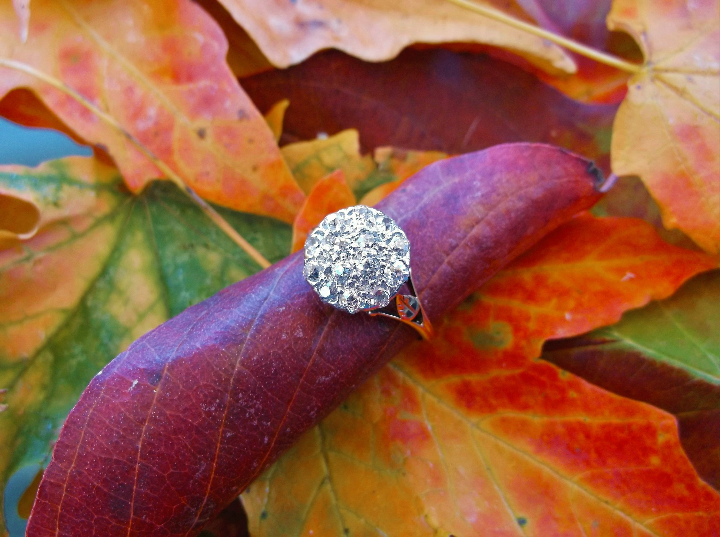 SOLD - This petite Edwardian era stunner packs a big punch! The ring is set with 1.00 carat total weight of Old Mine cut diamonds in a delicate platinum topped gold mounting.