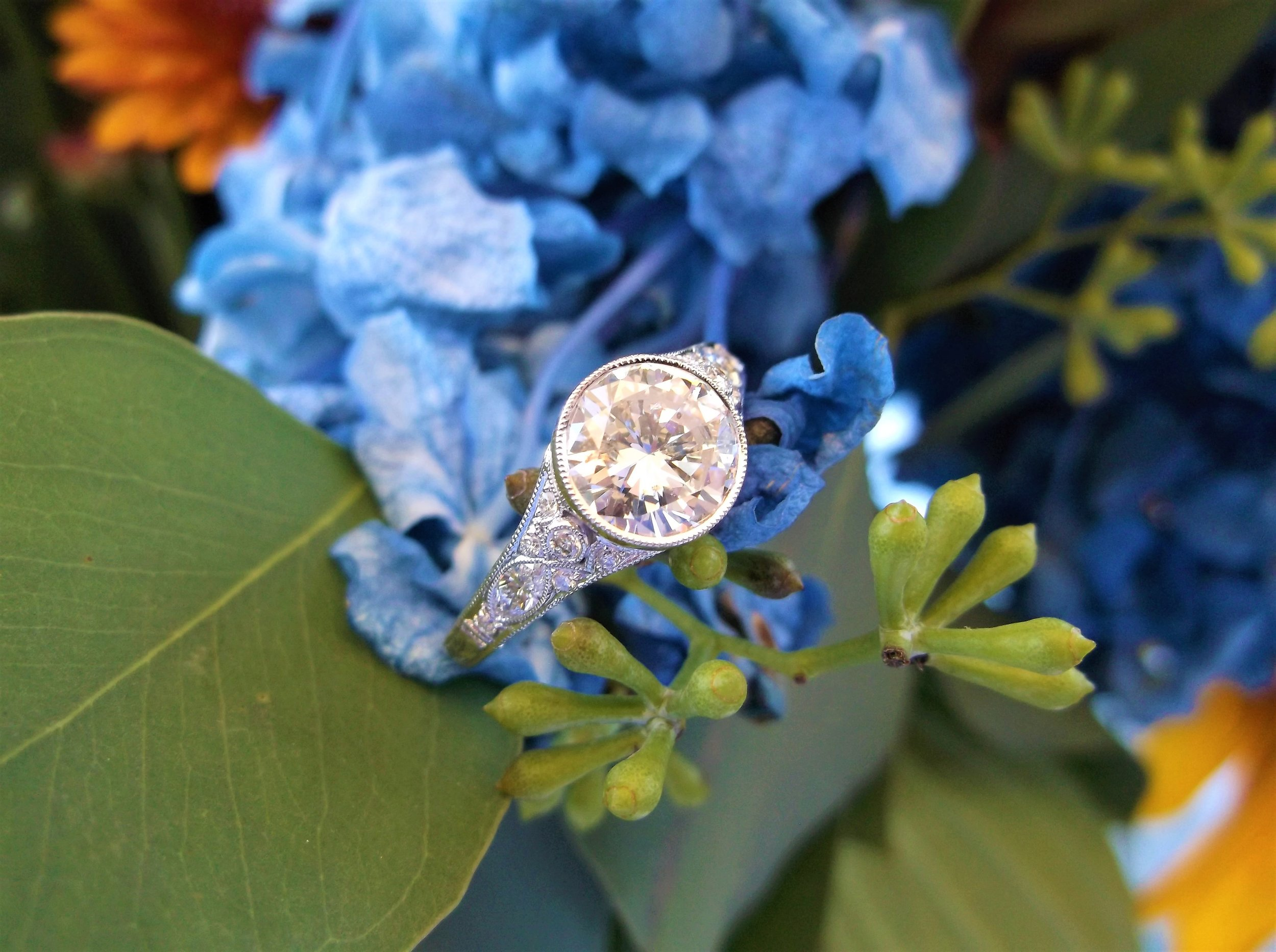 SOLD - Beautiful 1.42 carat round brilliant cut diamond set in a lovely diamond and white gold bezel setting.