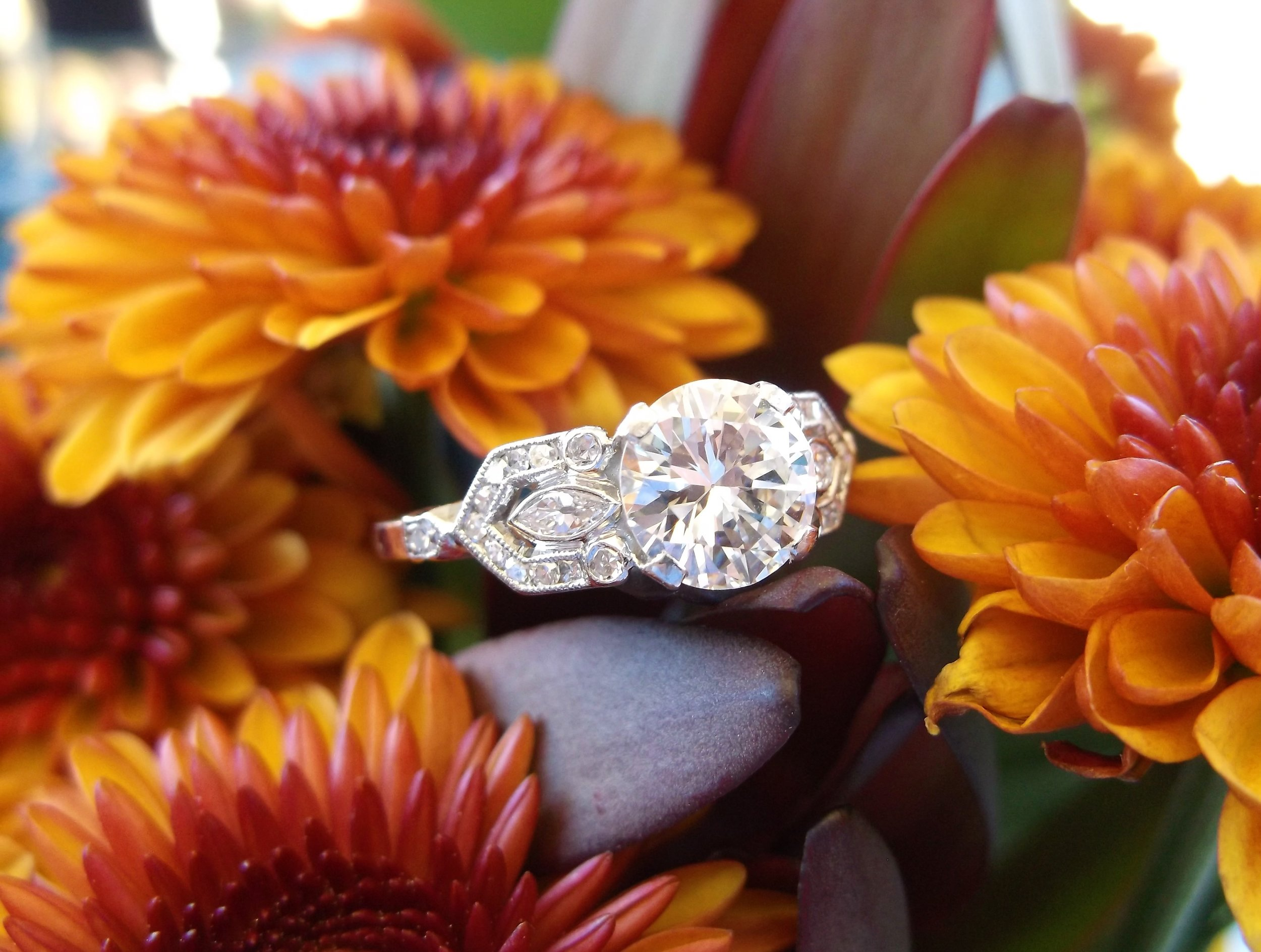 SOLD - Glamorous 1.24 carat Old European cut diamond set in a gorgeous diamond and platinum mounting.