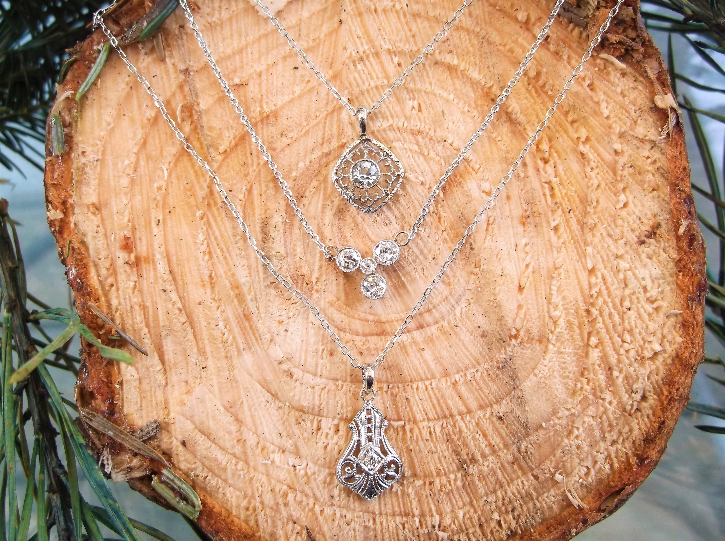 Top: SOLD - Art Deco aquamarine and filigree pendant set in white gold   Middle:  SOLD - Edwardian era, Old European cut diamond pendant set in platinum topped gold with 0.55 carats total weight in diamonds   Bottom: SOLD - 1920's filigree and diamond pendant in white gold