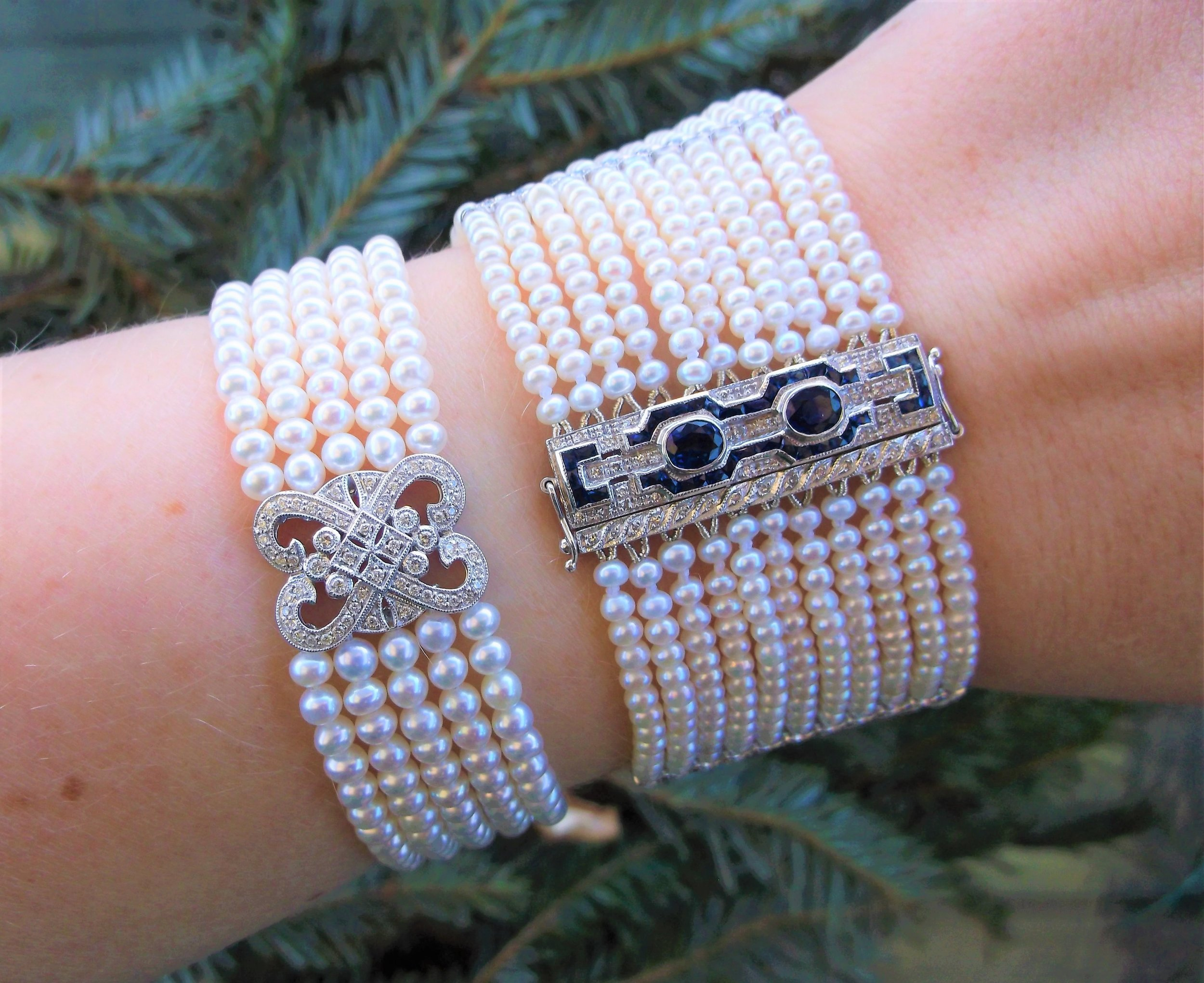 SOLD BOTH - An elegant eleven strand bracelet features a bar clasp set with 0.83 carats total weight in sapphires and 1.25 carats total weight in diamonds and a lovely five strand pearl bracelet set with 0.44 carats total weight in diamonds.