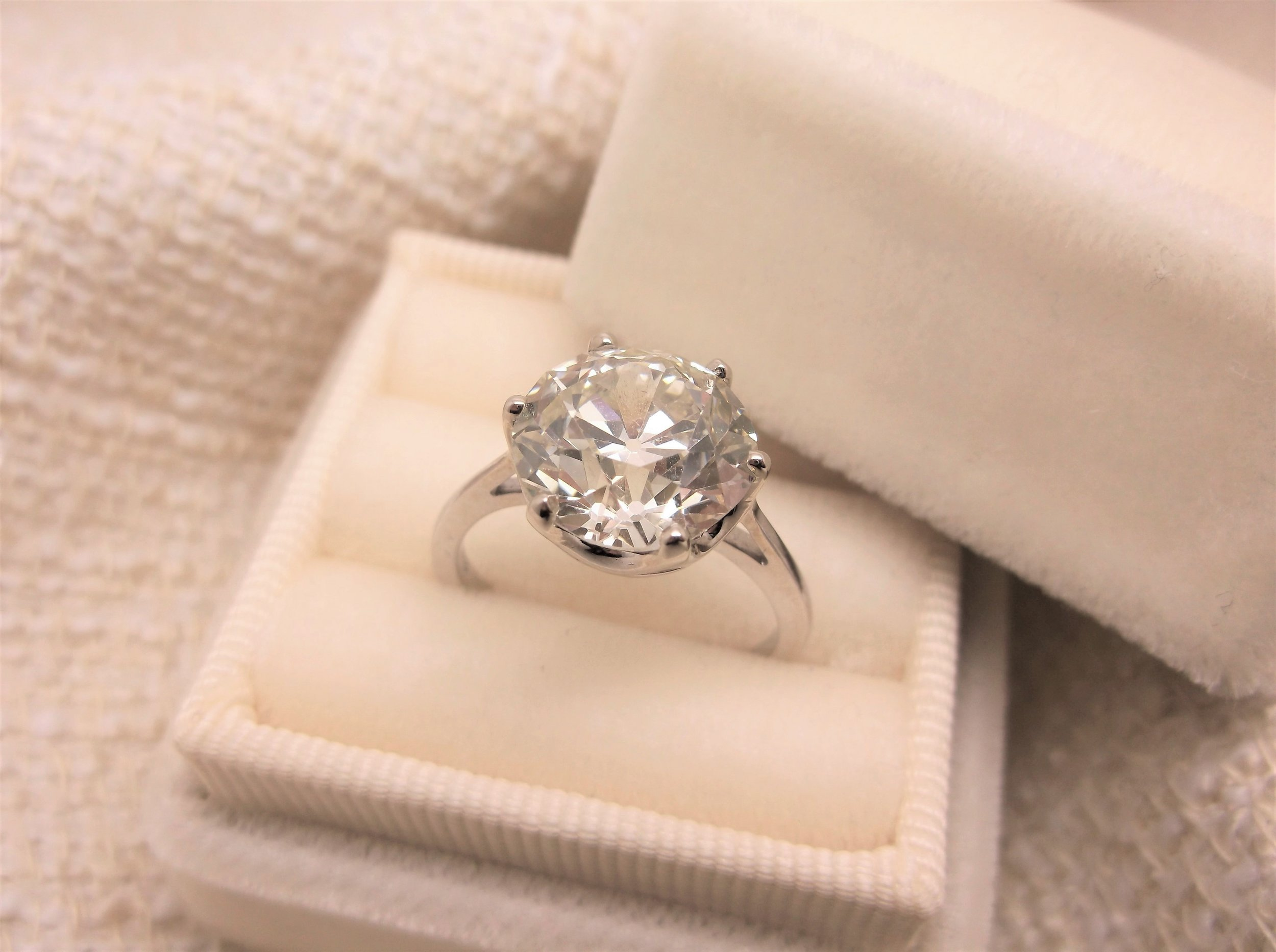 This stunning 5.04 carat Old European cut diamond is a timeless statement! Gorgeous on its own or paired with bands, you can do no wrong with this beauty!