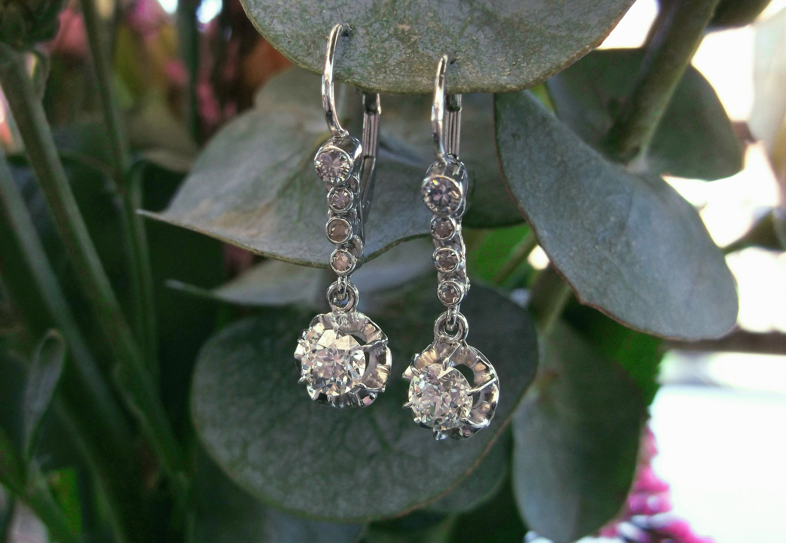 SOLD - A gorgeous addition to any wardrobe! From the 1920's, a pair of Old European cut diamond earrings with 1.00 carats total weight in diamonds set in white gold.