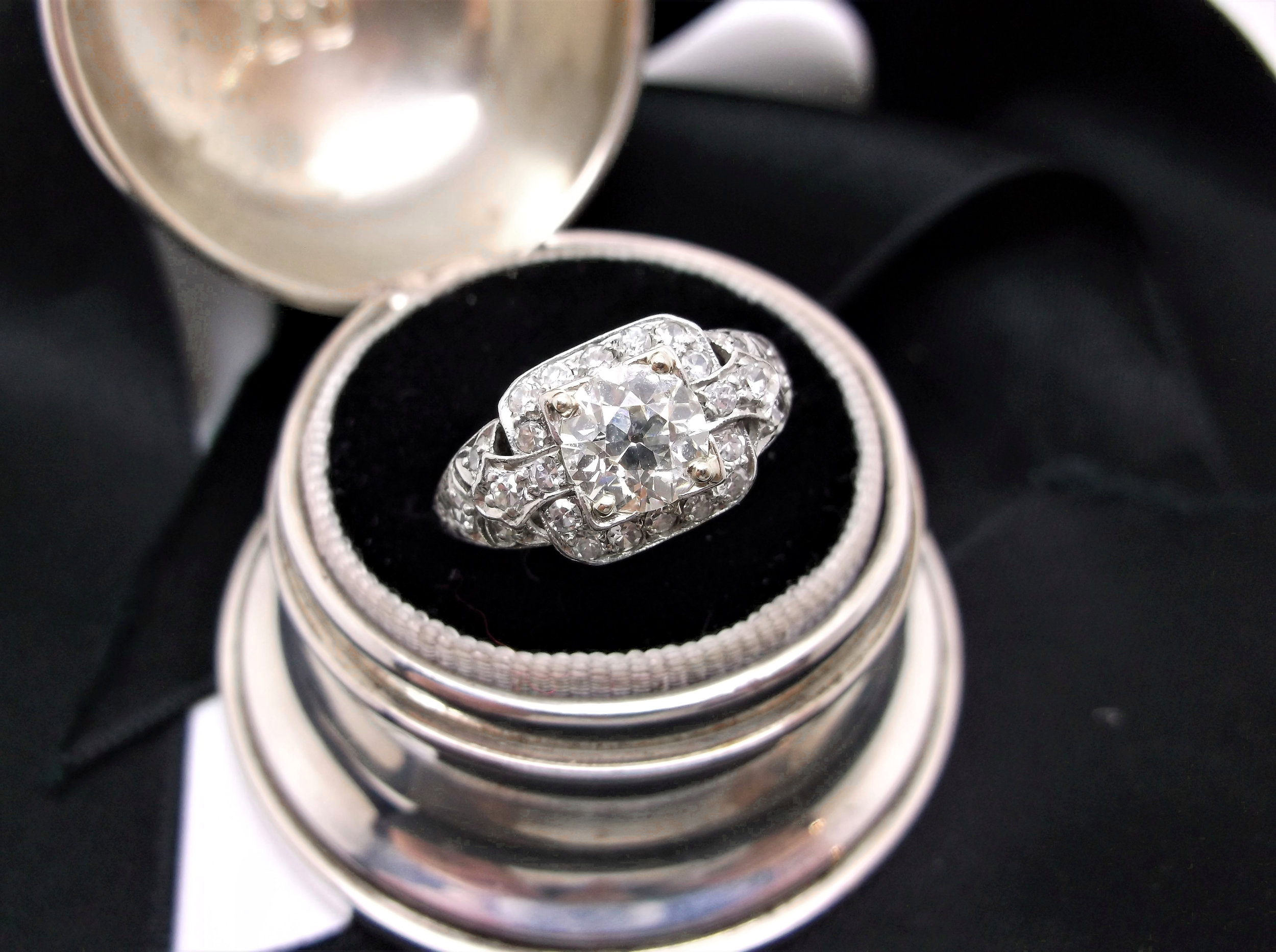 Gorgeous 1920's diamond and platinum ring, featuring a 1.05 carat Old European cut diamond in the center. Shop this ring  HERE