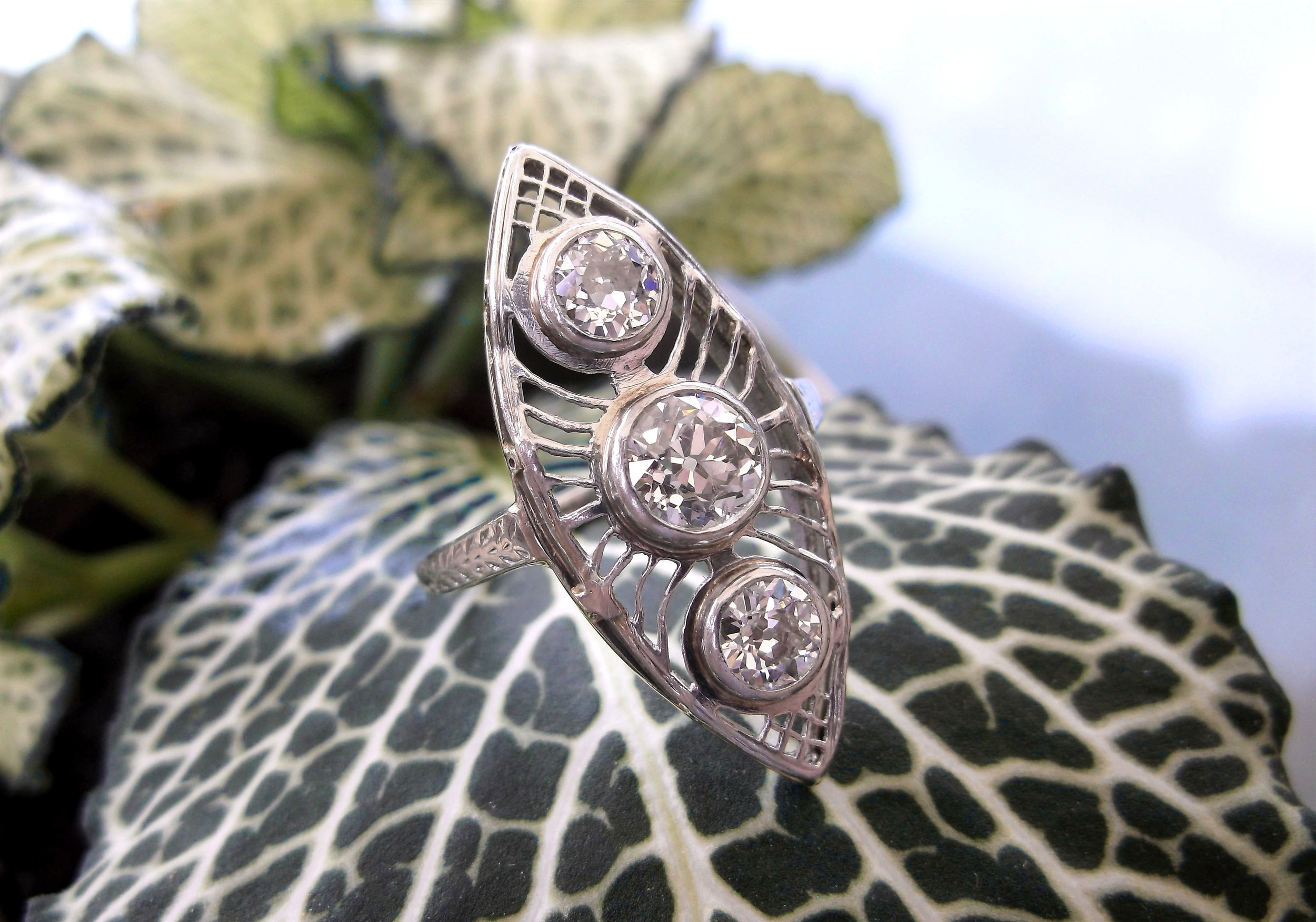 SOLD - Airy and intricate Art Deco Old European cut diamond ring with beautiful white gold filigree details. Shop this ring  HERE