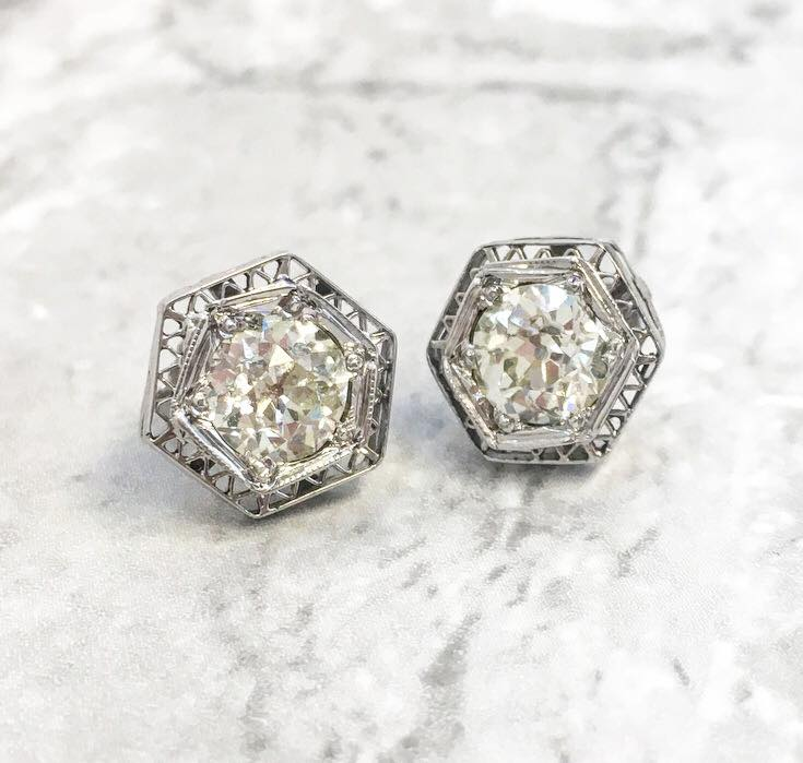 SOLD - A gorgeous twist on a classic diamond stud! Pair of Old European cut diamond earrings set in a platinum filigree stud setting, featuring a 0.80 carat Old European cut diamond in each.