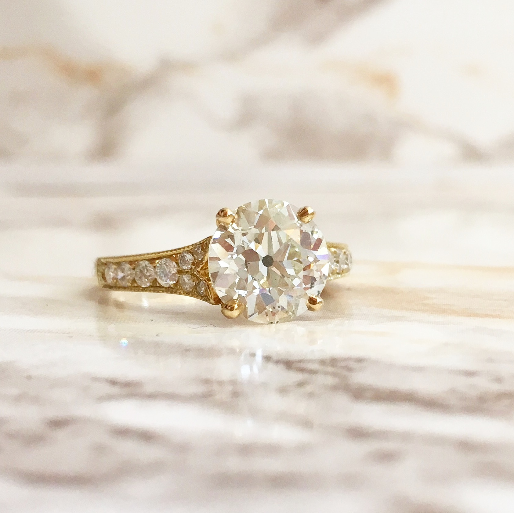 Beautiful 2.46 carat Old European cut diamond set in a yellow gold and diamond detail mounting. Shop this ring  HERE