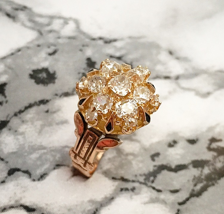 Fabulous Victorian era Old Mine cut diamond cluster ring set in yellow gold, featuring 1.70 carats total weight in diamonds with black enamel and hand engraving detail. Shop this ring  HERE