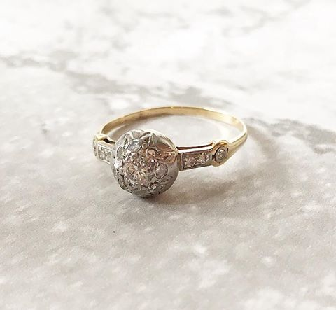 SOLD - Uniquely Edwardian platinum topped gold and diamond ring featuring 0.27 carats total weight in diamonds, set in a fabulous ball shaped cluster mounting.  Shop this ring  HERE