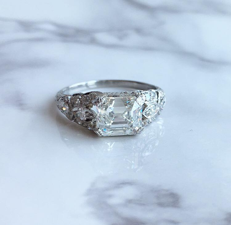 SOLD - Dream worthy 1920's 2.06 carat step cut diamond set in a gorgeous platinum mounting with 0.25 carats in accent diamonds! Shop this ring  HERE