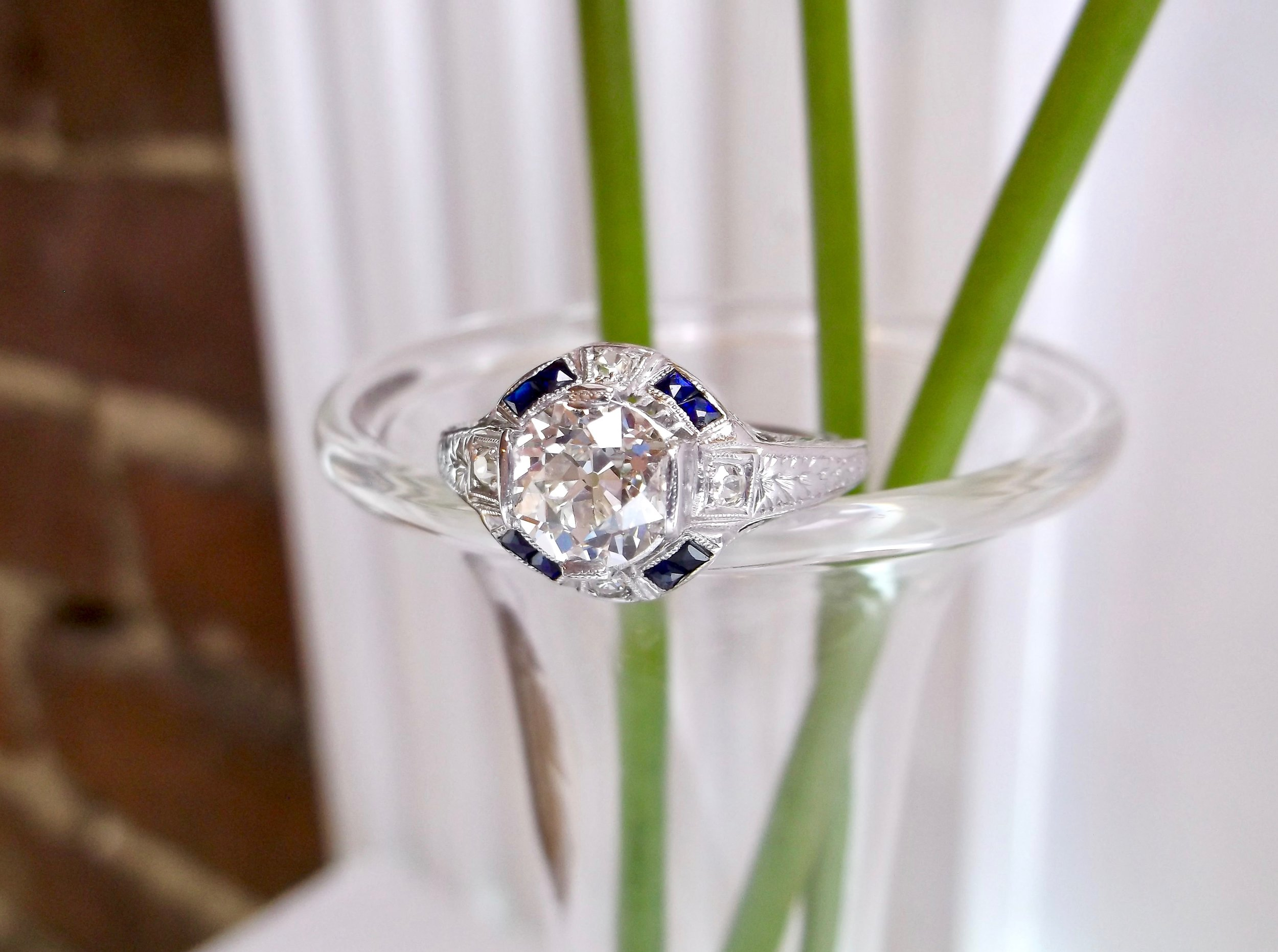It's all in those eye catching sapphire details with this gorgeous 1930's diamond ring! The ring features a center 1.40 carat Old European cut diamond, beautifully complimented by 0.12 carats in accent sapphires and 0.10 carats in accent diamonds, all set in platinum. Shop this stunning ring  HERE