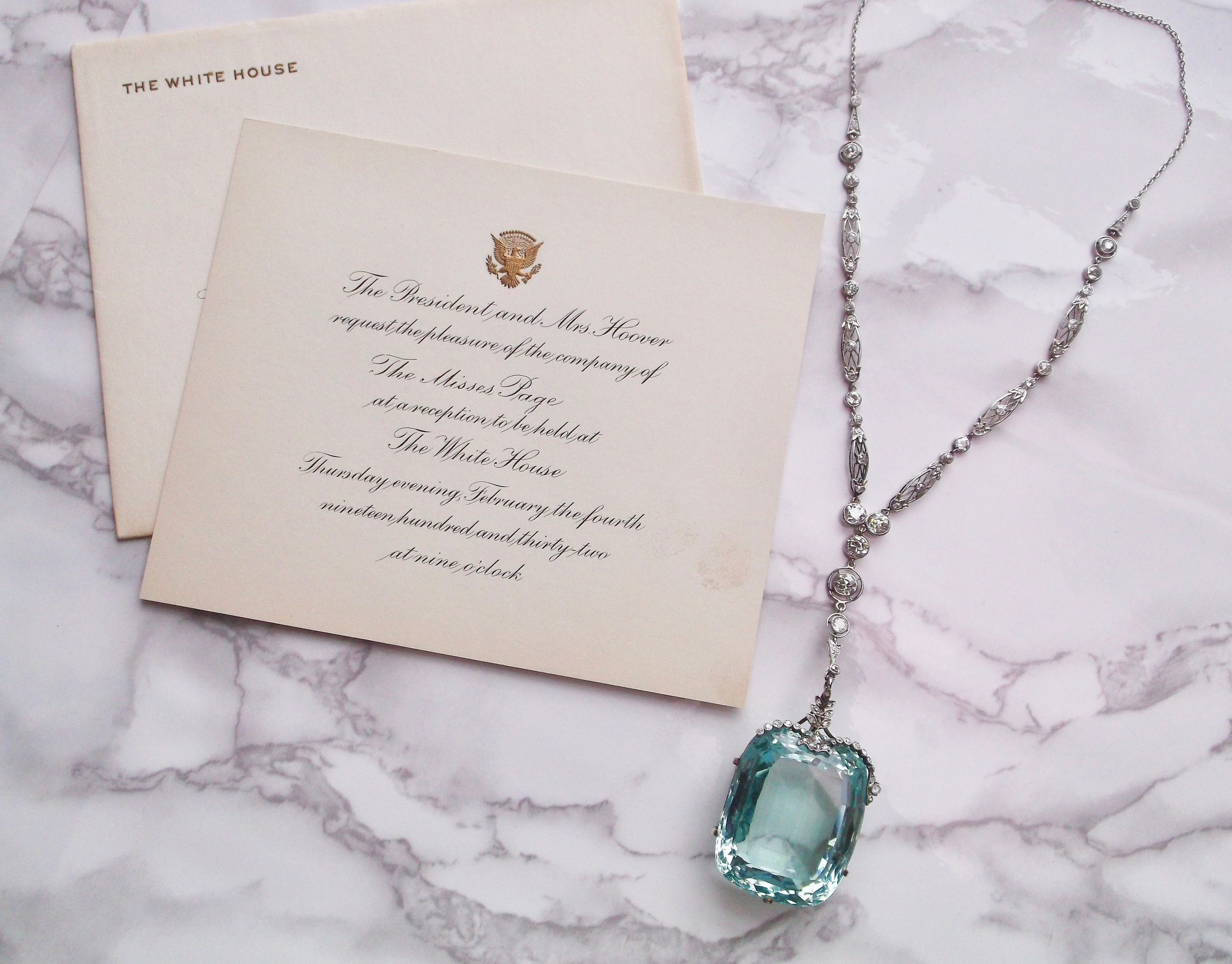 "Meet Miss Page.   This jaw droping-ly gorgeous 180 carat aquamarine, diamond and platinum necklace has been to the White House! This beauty was worn by Miss Page in 1932 to a White House dinner hosted by President Hoover and First Lady Hoover.  The invitation reads:  ""The President and Mrs. Hoover request the pleasure of the company of The Misses Page at a reception to be held at The White House Thursday evening, February the fourth nineteen hundred and thirty-two at nine o'clock.""   This stunning piece can be yours (to wear to The White House, or, you know, just with your pj's on the couch!)! Shop  HERE"