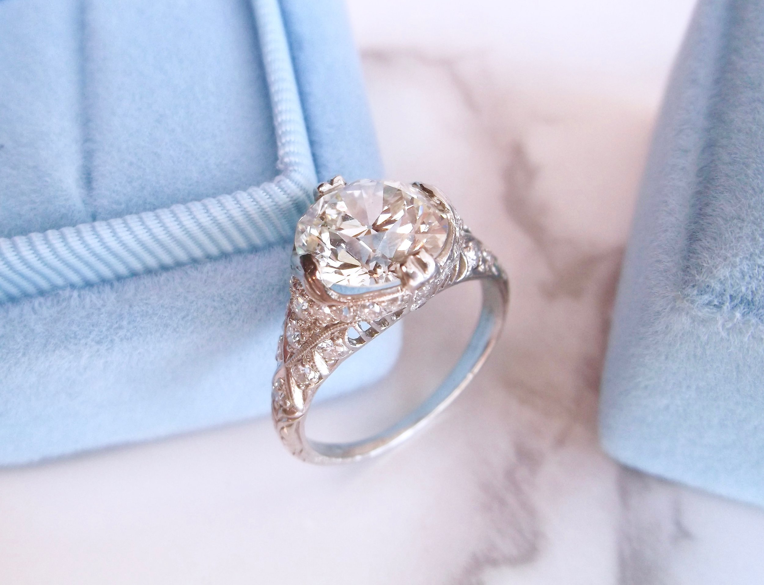 Exceptional 1920's diamond and platinum ring featuring a center 2.99 carat Old European cut diamond with gorgeous filigree and diamond accents in the mounting.  Shop this ring  HERE