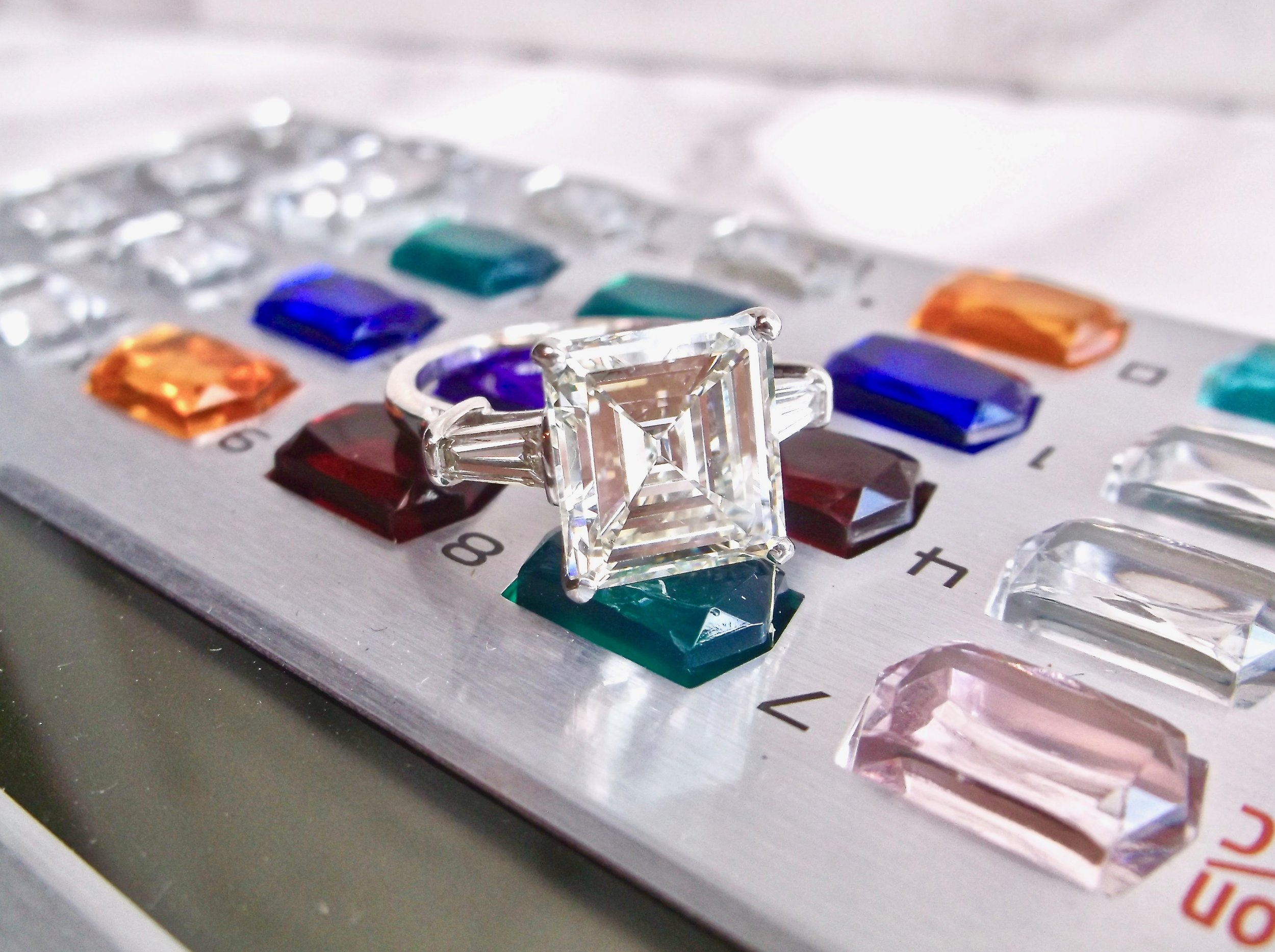 We're crunching some numbers trying to figure out how all of the Walton's ladies can share this bad boy! A fabulous 5.20 carat asscher cut diamond set in a platinum and baguette cut diamond mounting.  Shop this stunner  HERE