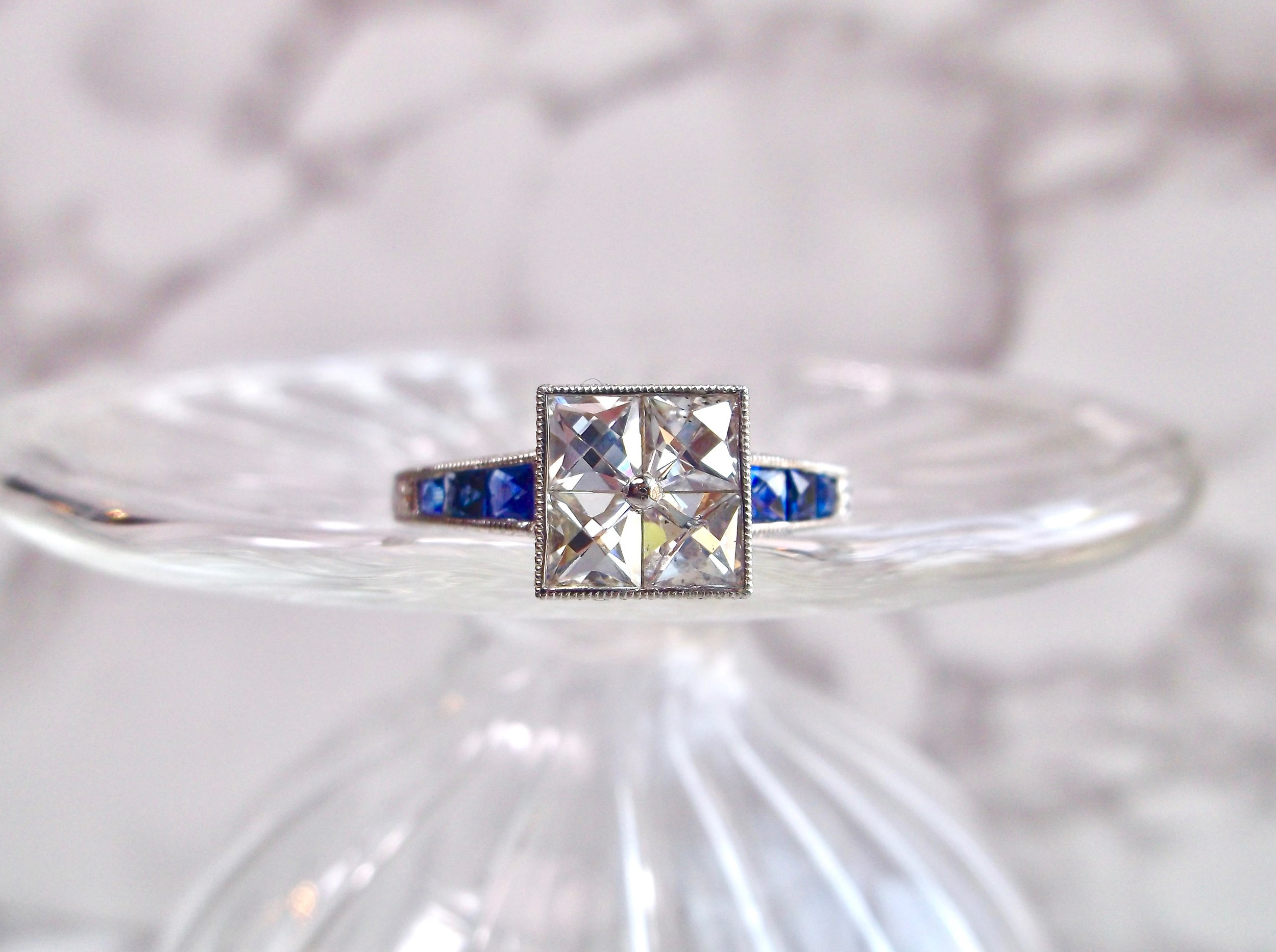 Oh my! We are so in love with this Art Deco inspired French cut diamond and blue sapphire ring! You must click the link below to see all of the hand engraved details on the platinum mounting! Shop this beauty  HERE .