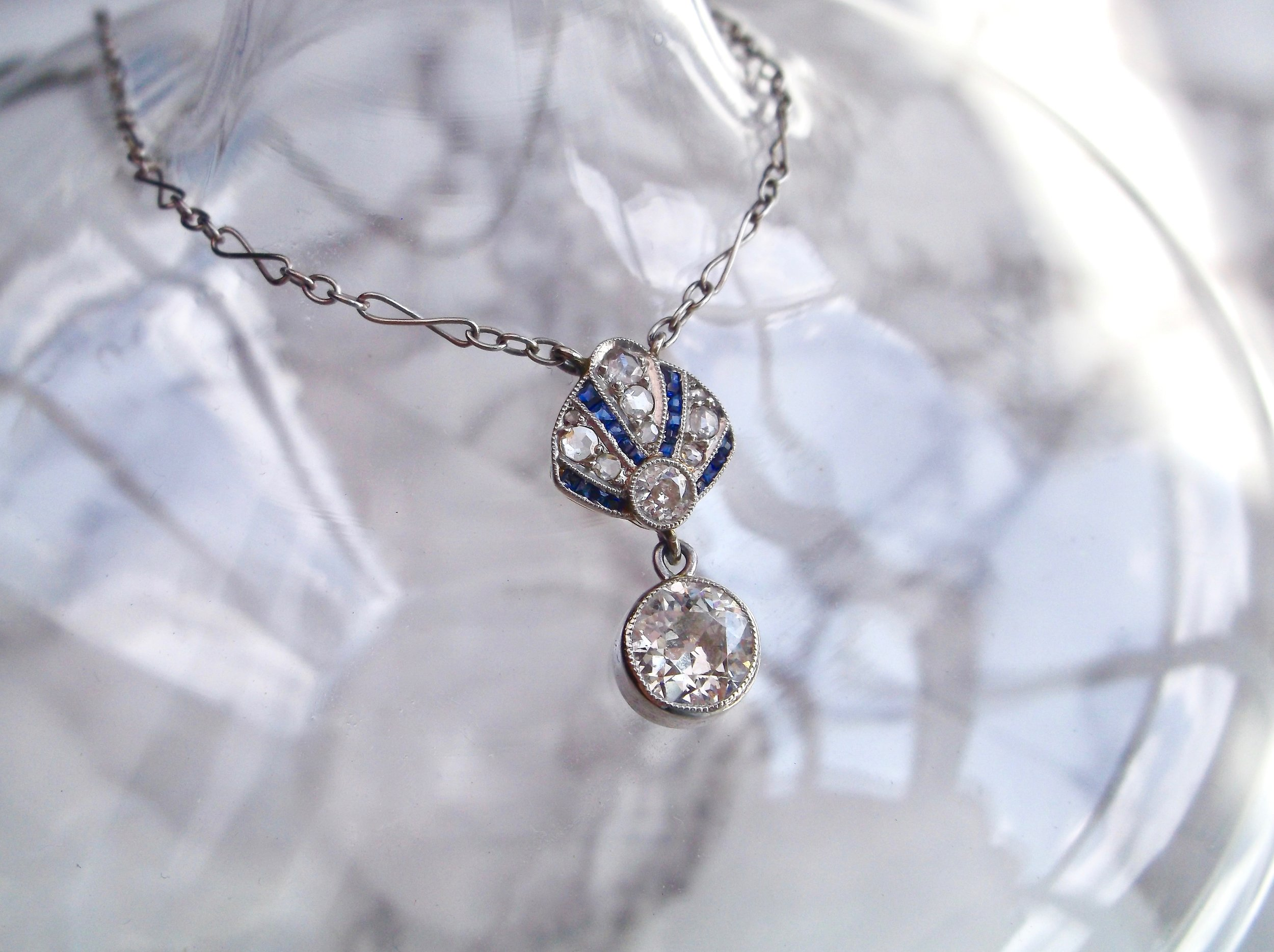 Dress it up or dress it down, this stunning Old European cut diamond pendant with sapphire accents is a showstopper!Shop this fabulous necklace  HERE .