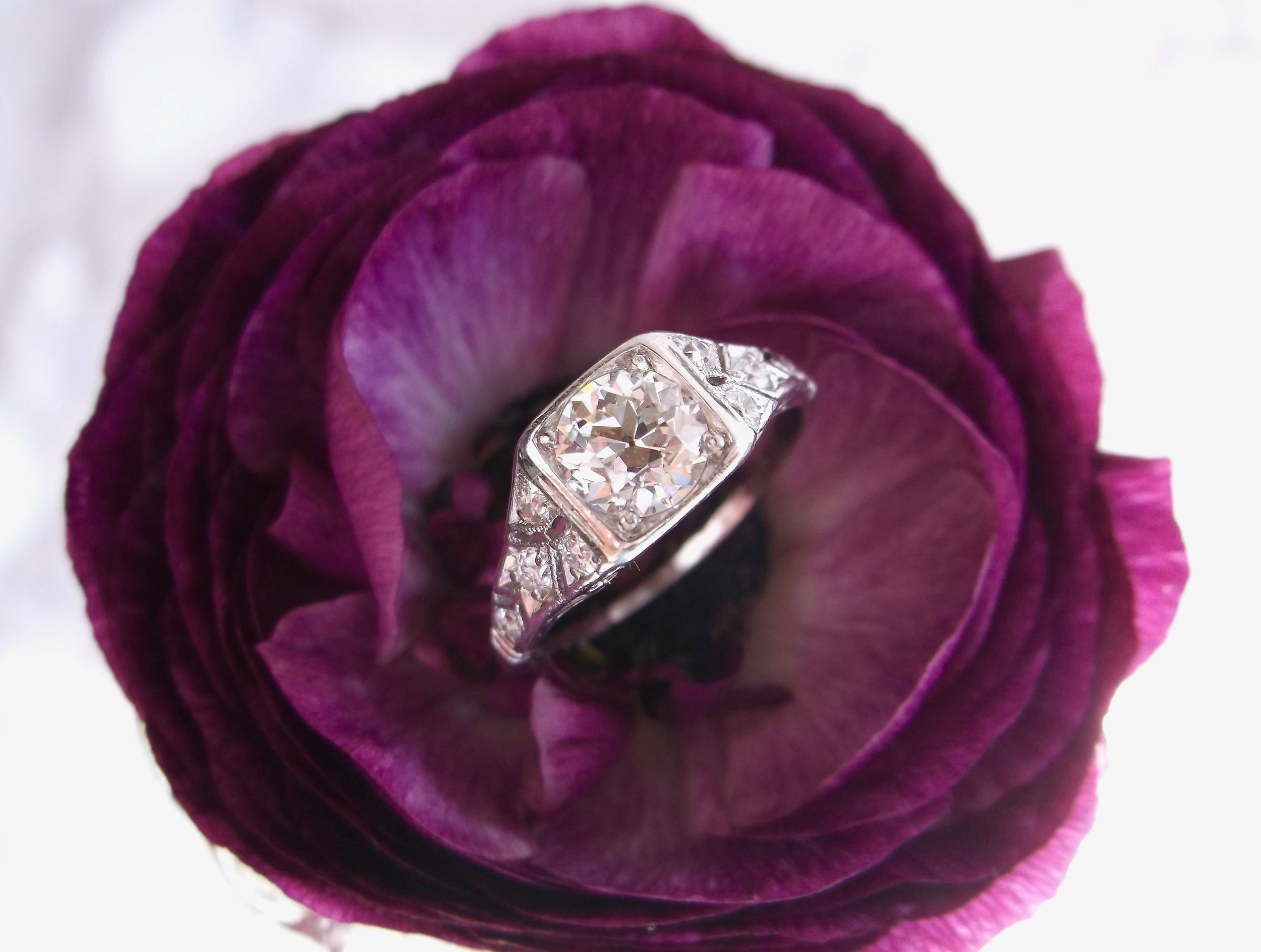 1920's classic beauty featuring a center 0.70 carat Old European cut diamond with diamond accents all set in platinum. Shop this gorgeous ring  HERE .