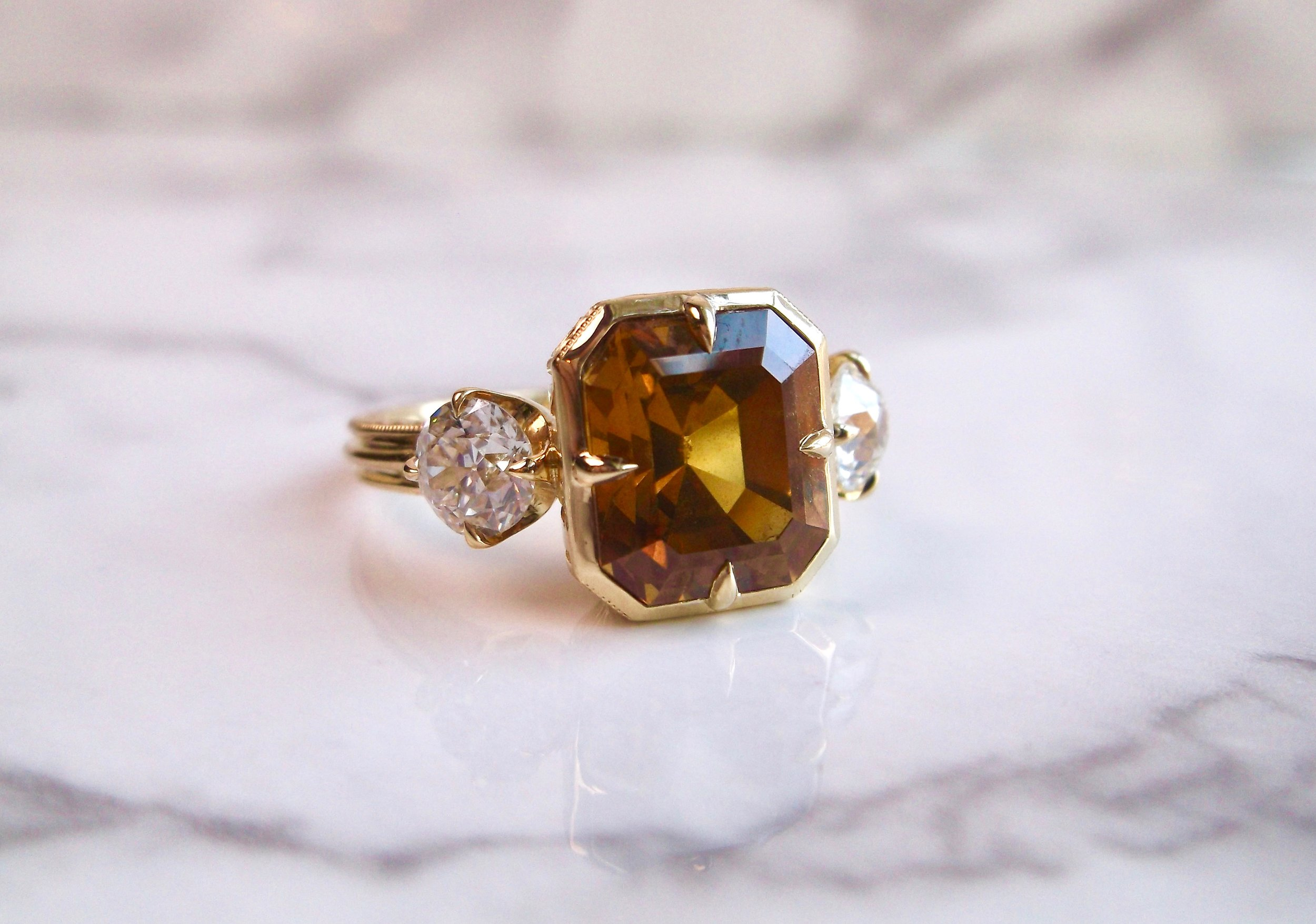 Excuse us while we pick our jaws up off the floor! This fabulous 4.38 carat golden honey colored sapphire and diamond ring is to die for! See her in all her glory  HERE .