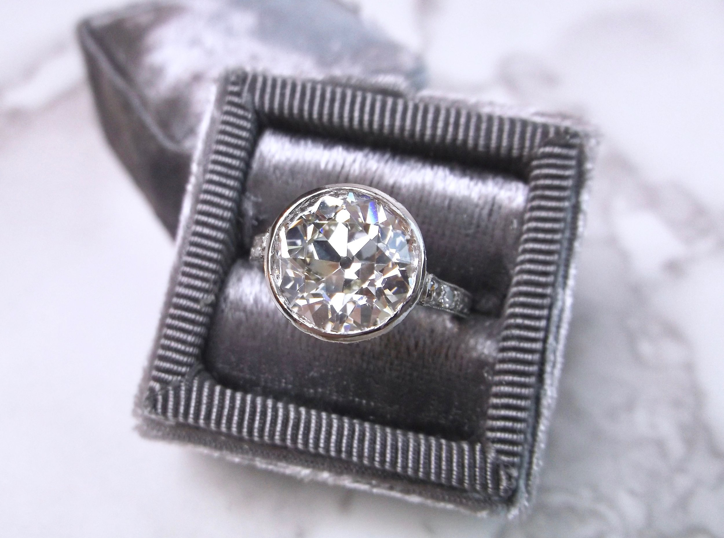 Jaw droppingly gorgeous 4.07 carat Old European cut diamond ring set in a beautifully detailed platinum setting.  Shop this stunner  HERE .
