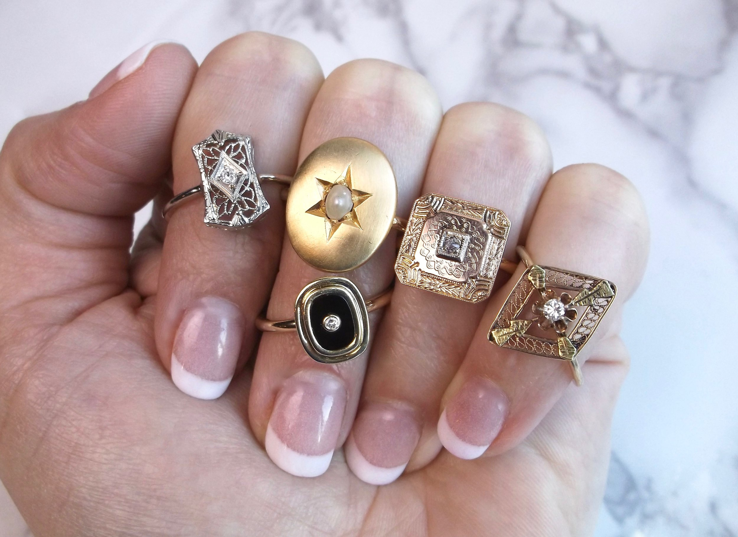 These once Victorian and Art Deco era stick pins and cuff links have been given new life as lovely rings! Shop these beauties  HERE  and  HERE . (And they are all under $350!)