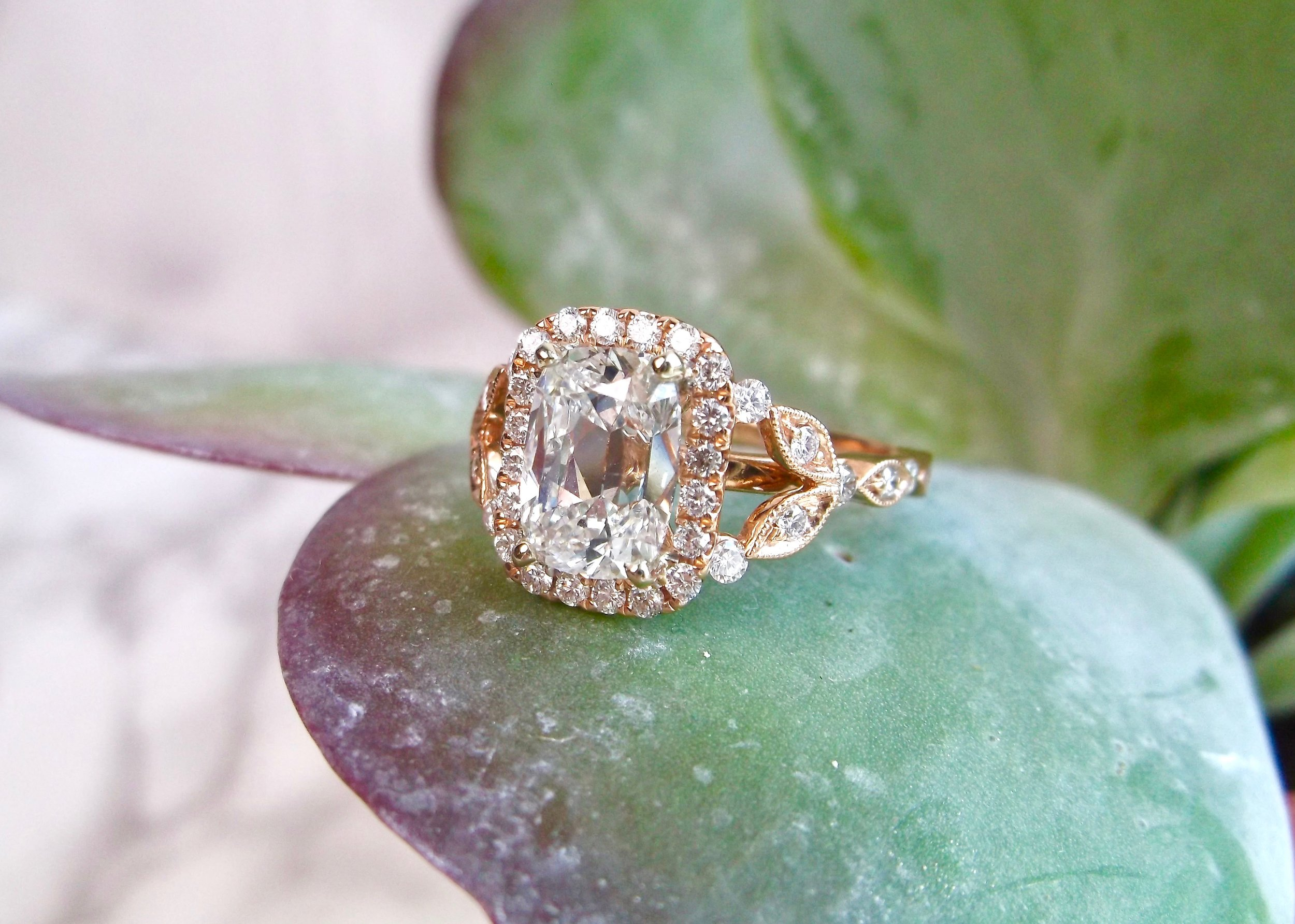 1.73 carat antique cushion cut diamond ring set in rose gold perfection. Shop this breathtaking beauty  HERE .