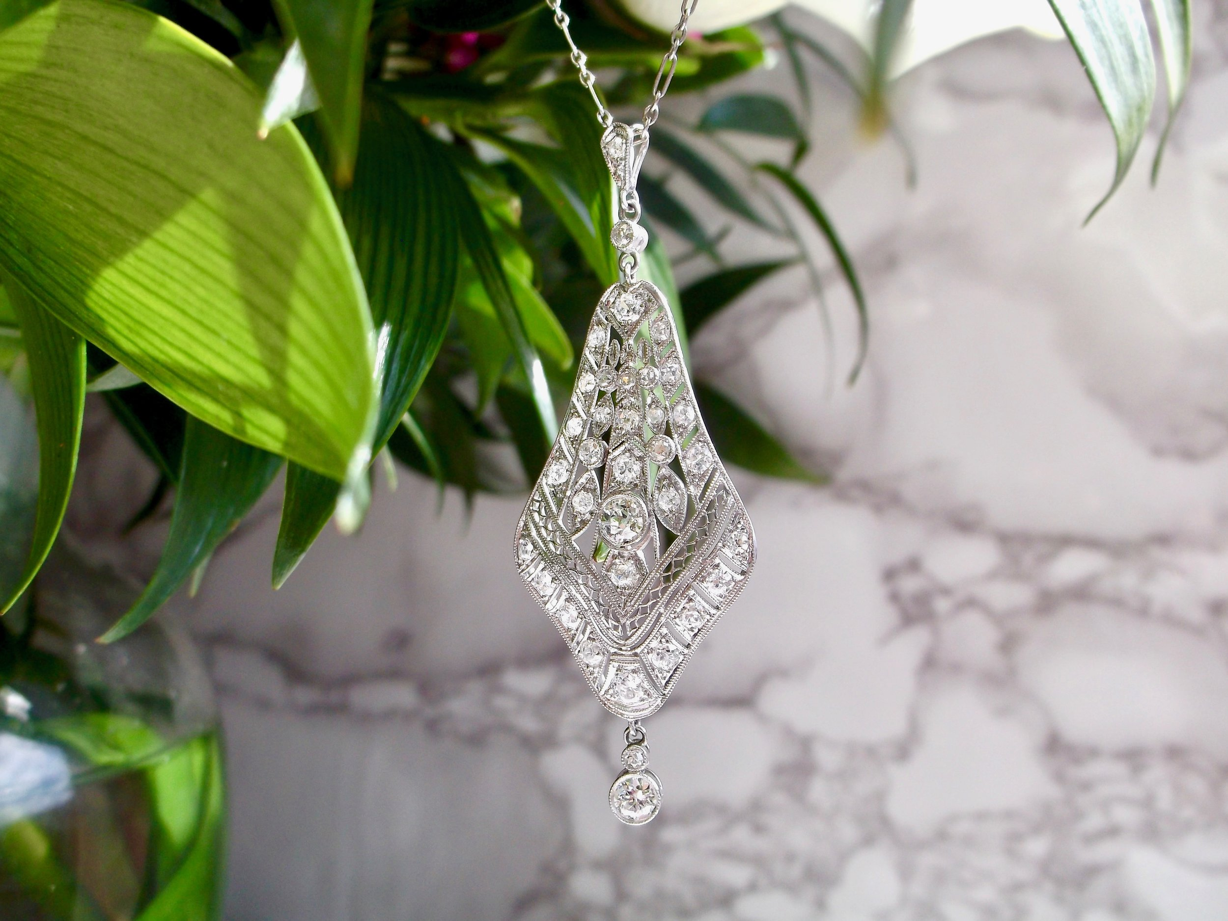 A feminine, Art Deco beauty! Shop this fabulous Old European cut diamond and platinum necklace  HERE .