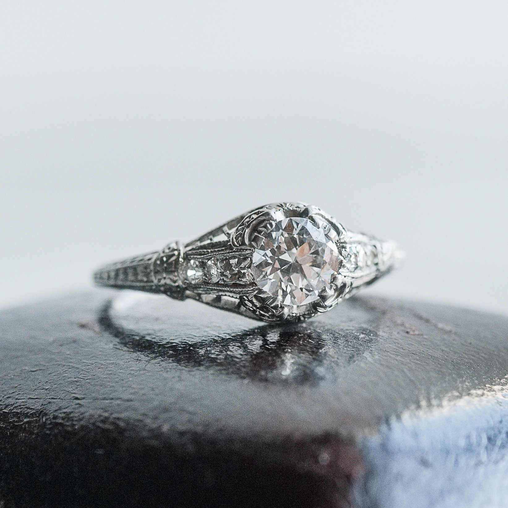We are headed into the weekend dreaming of this beauty! Circa 1920's 0.57 carat Old European cut diamond paired with fabulous filigree and diamond details. Shop  HERE .