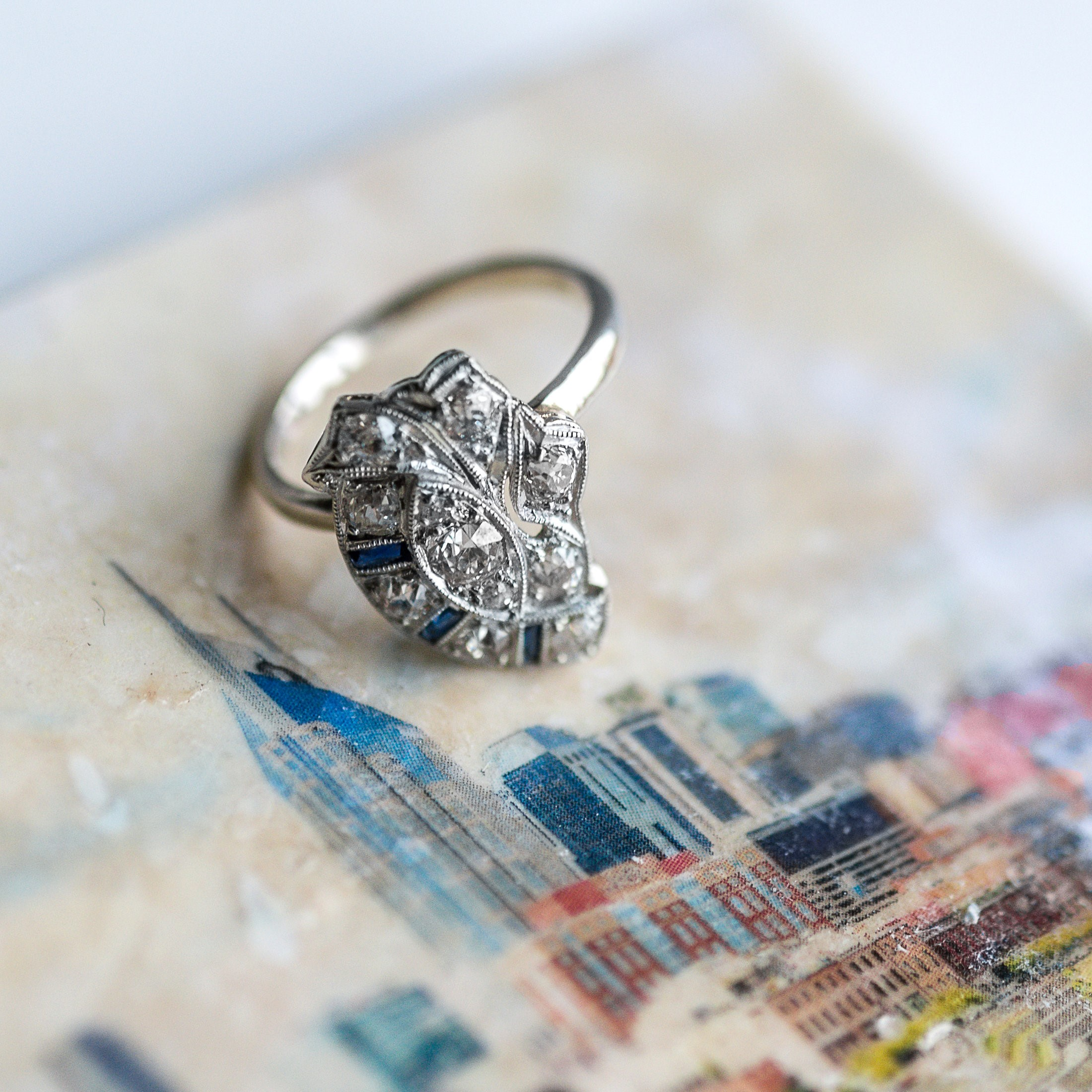 Bright lights, big city 💎🏙️ We are loving this Art Deco diamond and sapphire ring that was once a stick pin! Shop this lovely ring  HERE .