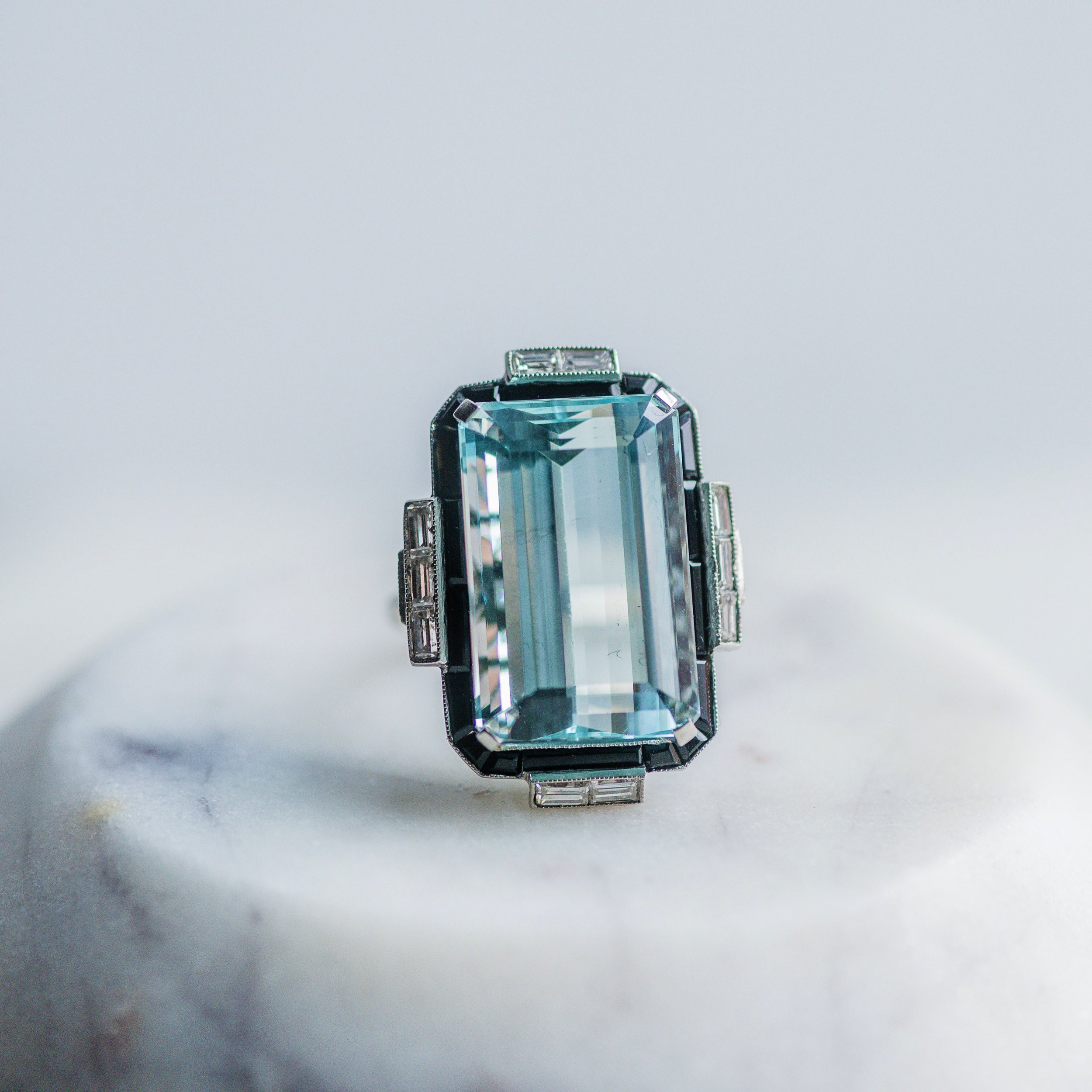 We are just going to stare into the depths of this ocean blue aquamarine and pretend we are on the beach for spring break! Shop this stunning ring  HERE .