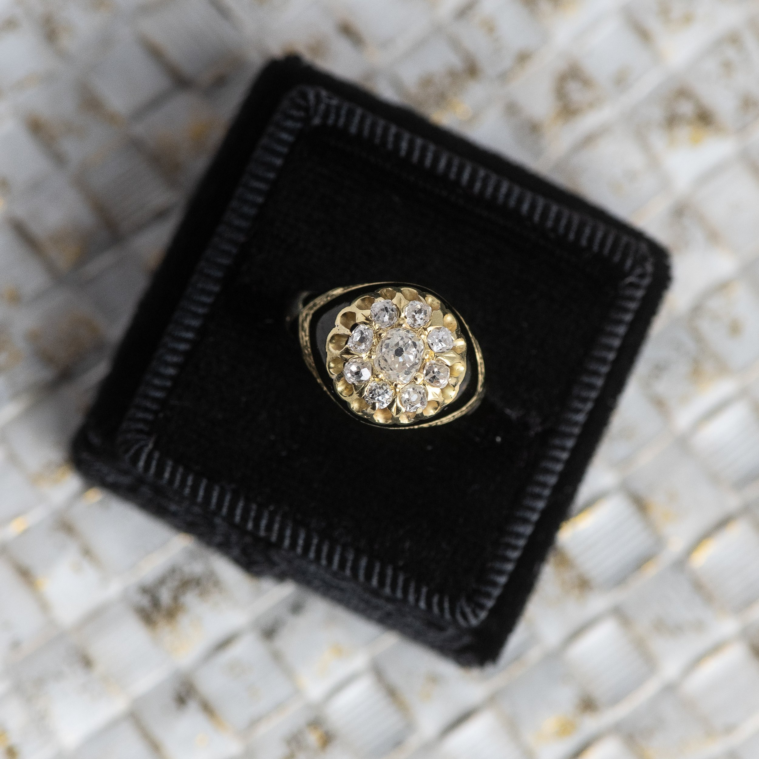 This Old Mine cut diamond cluster ring features to die for black enameling and engraving details! Click  HERE  to view this beauty in all its glory!