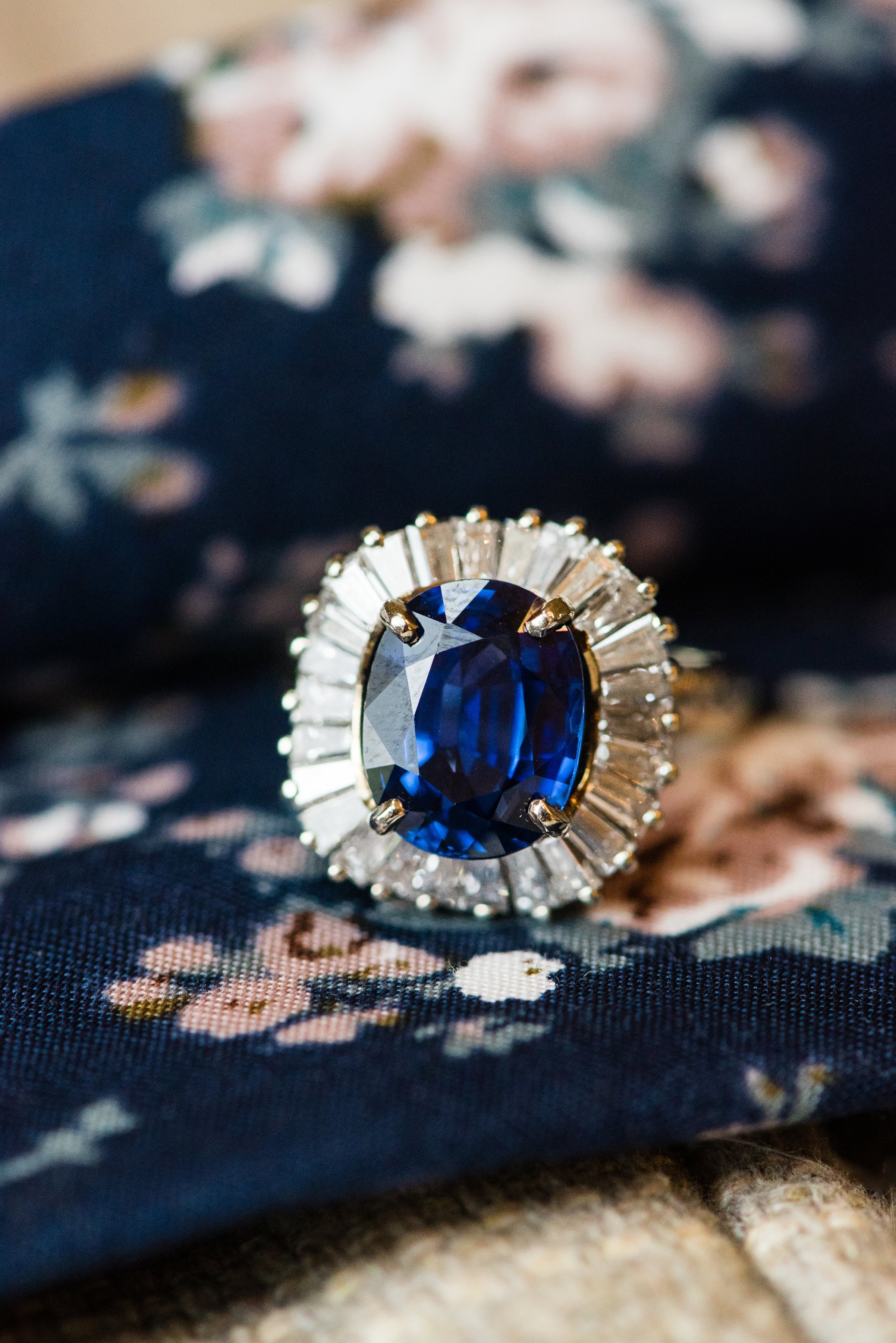 A decadent 4.25 carat blue sapphire set in a feminine ballerina style mounting comprised of 1.00 carats of baguette cut diamonds! Shop this show stopper  HERE .   Photography by Ivory Door Studio.