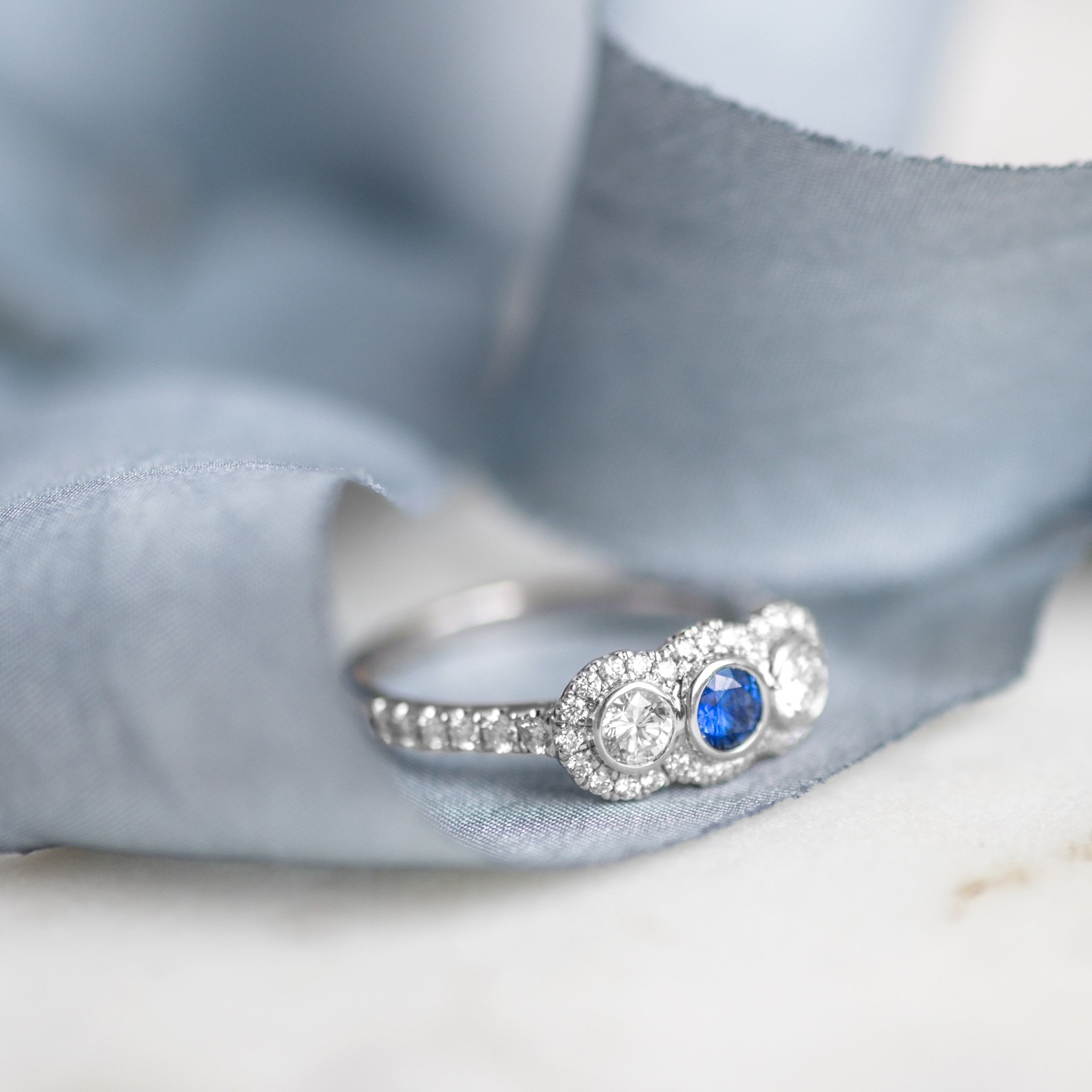 A three stone beauty! Shop this lovely diamond and sapphire ring  HERE .