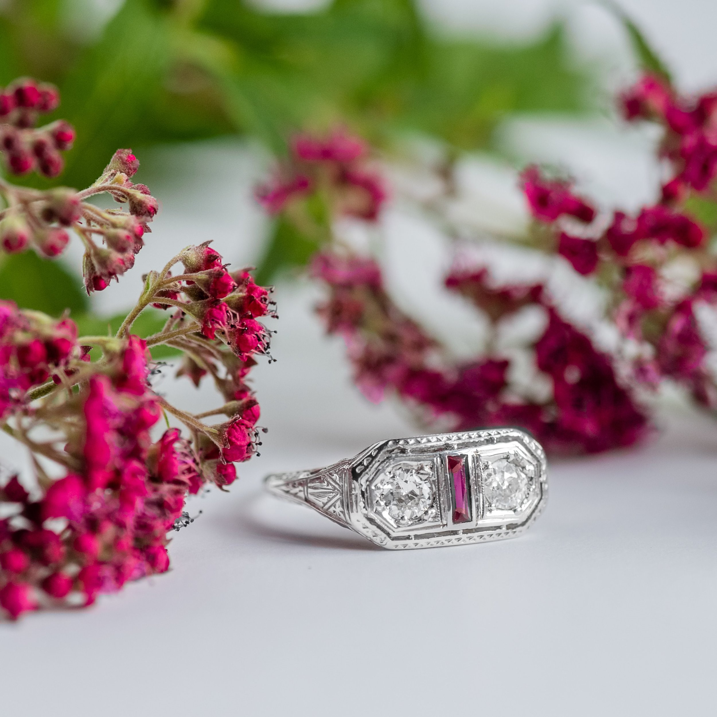 A little pop of color in this beautiful Art Deco diamond and ruby ring! Shop  HERE .