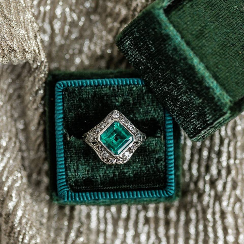Absolutely stunning Art Deco emerald, diamond and platinum ring. Call our showroom to shop!