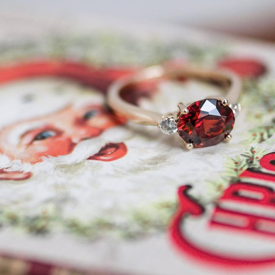 Merry Christmas Eve! Nothing quite says Christmas like the gorgeous hue of this garnet and diamond ring! Call our showroom to shop!