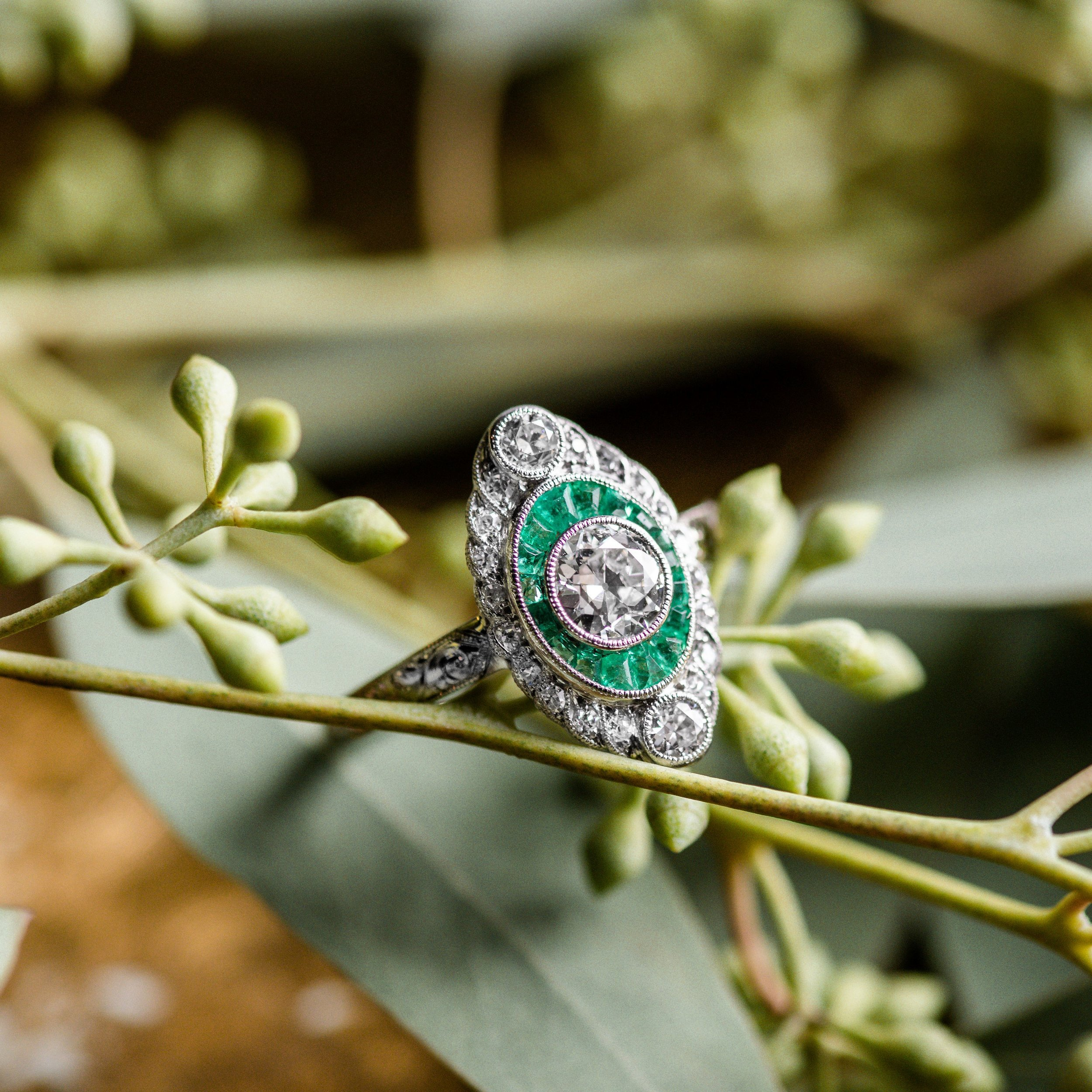 Mesmerizing Edwardian era emerald and diamond ring featuring a center 0.50 carat Old European cut diamond. Click  HERE  to shop this beauty!